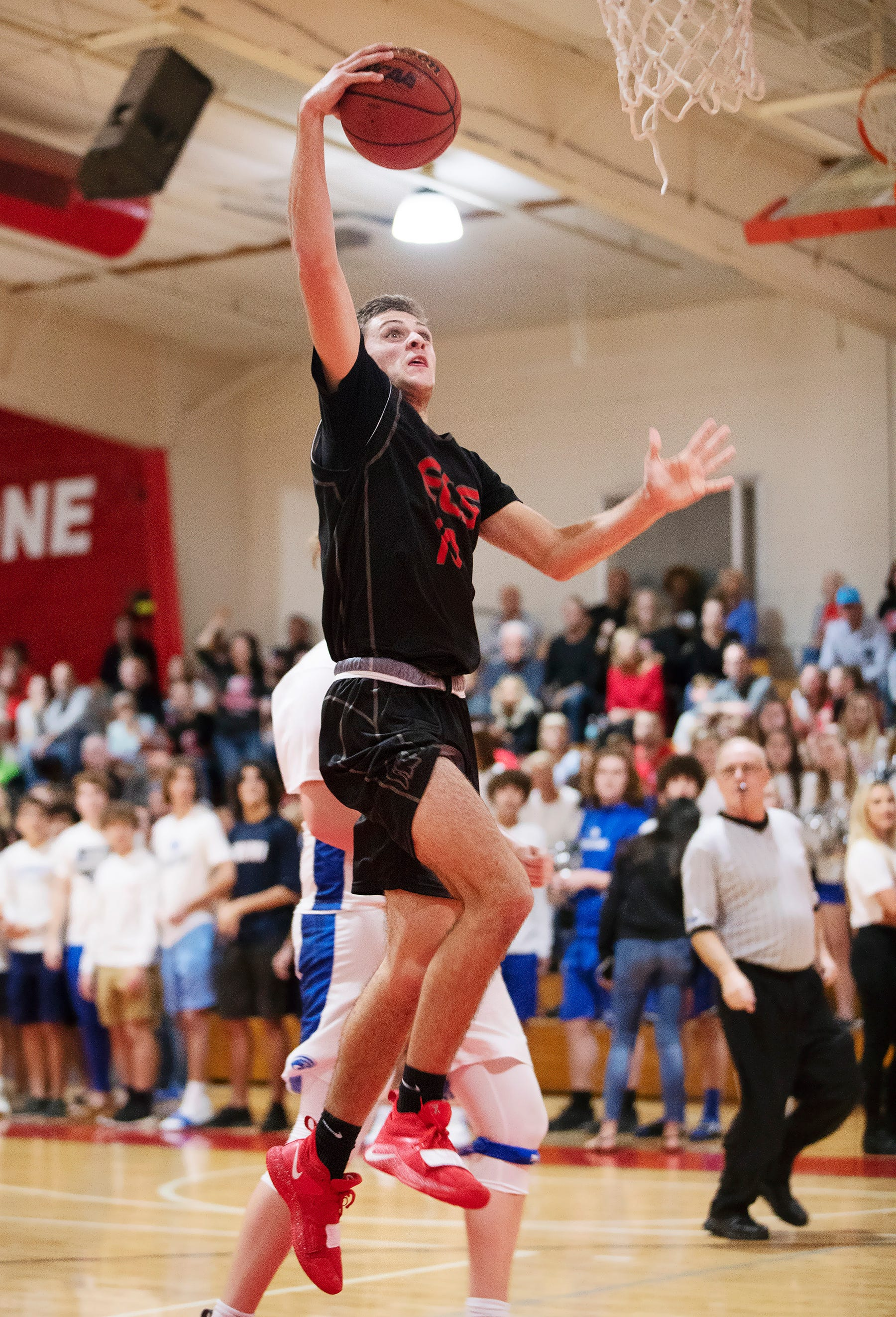 Evangelical Christian School's (ECS) Sean Shore dunks against Canterbury on Friday at ECS in Fort Myers. ECS beat Canterbury 63-47.