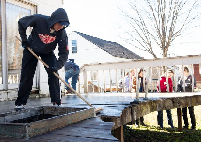 Bob Jones University students work with Home Works of America to renovate a home on Durham Street in Greenville on Martin Luther King, Jr. Day Monday, Jan. 21, 2019.
