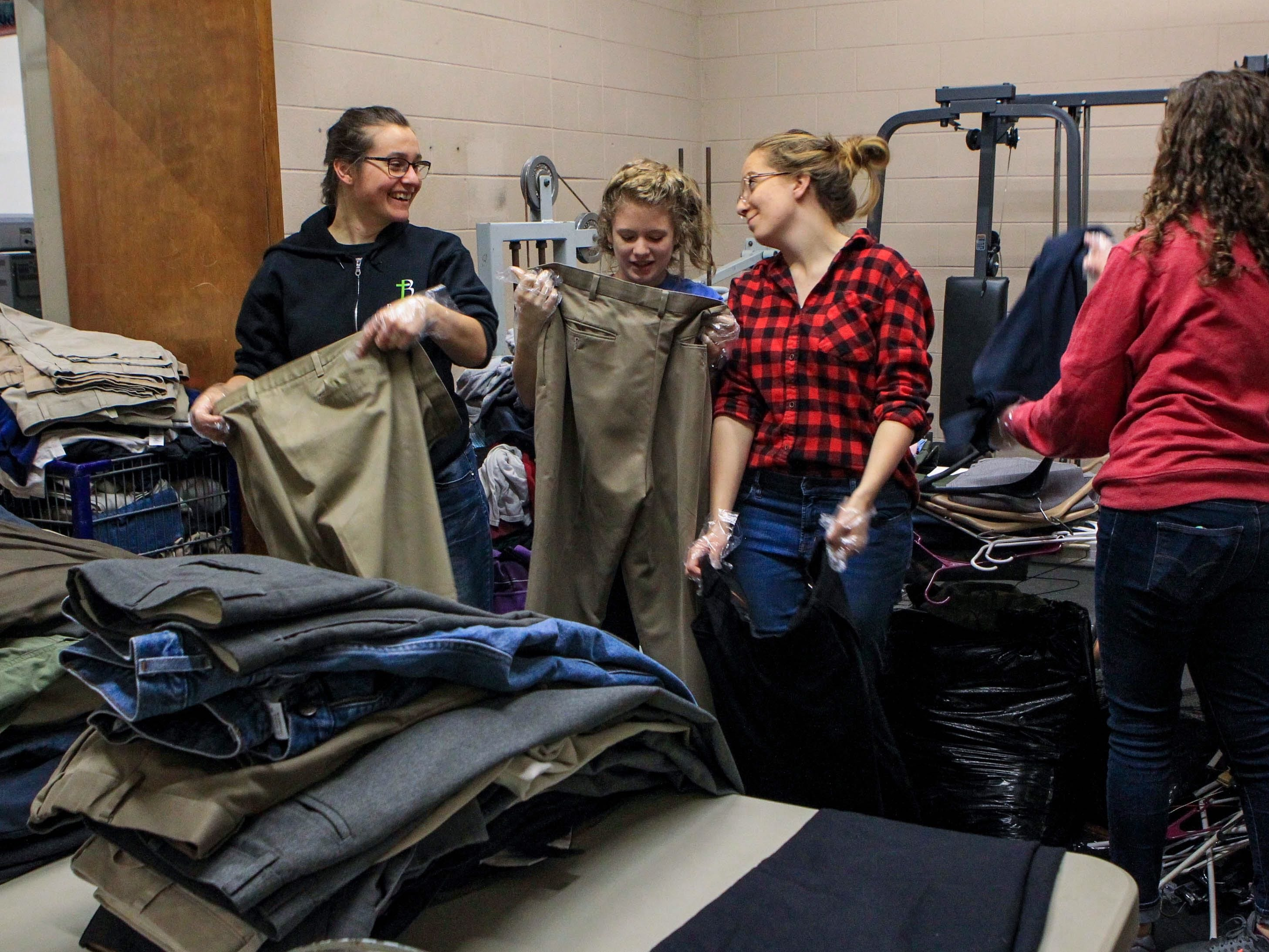 Suzanna Millington, a junior, Taylor Holland, a sophomore, Karen Mee, a sophomore, and Jennifer Naas, a sophomore, sort through pants by sizes at Miracle HillÕs Greenville Rescue Mission on Martin Luther King, Jr. Day Monday, Jan. 21, 2019.