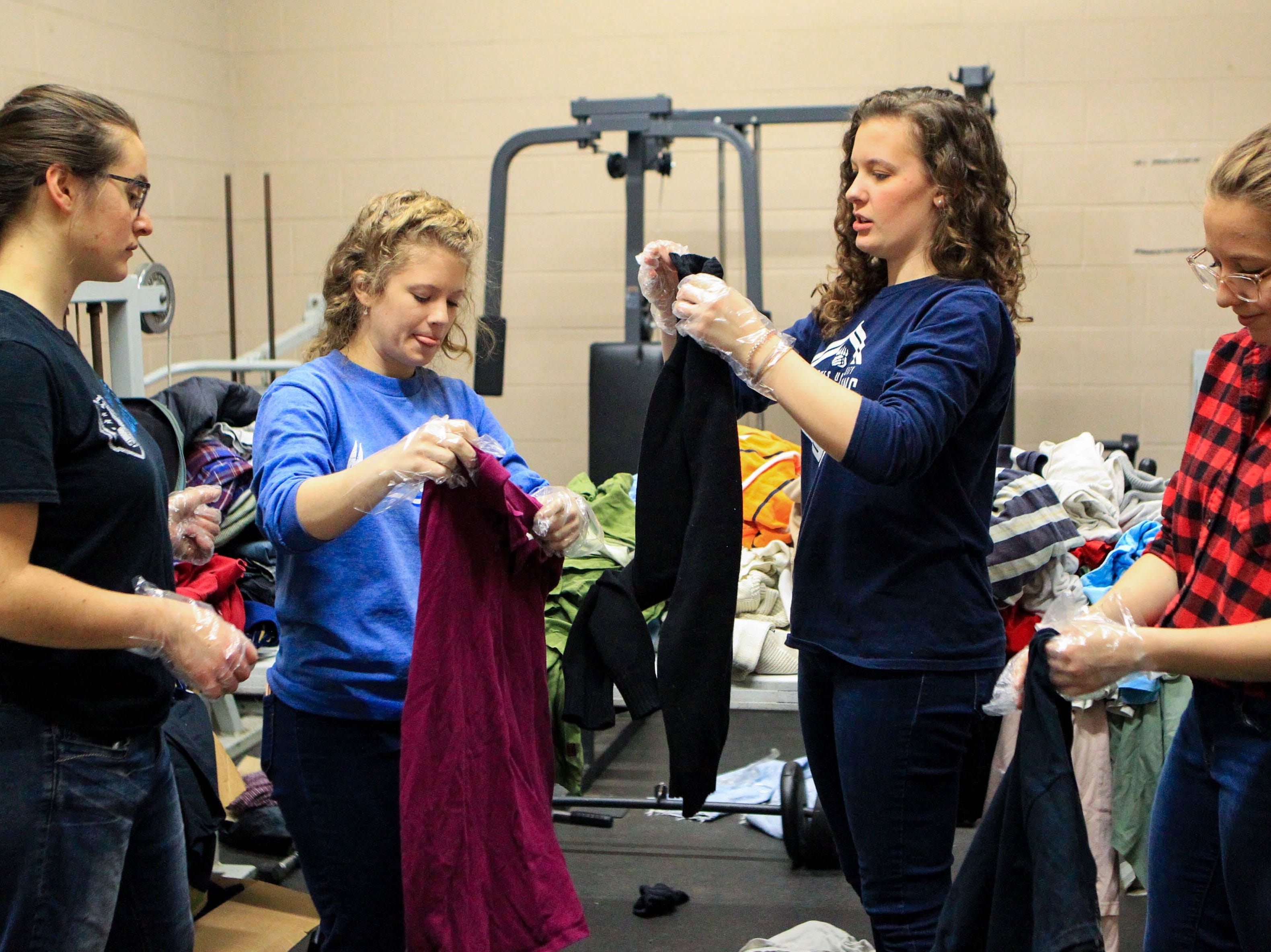 Suzanna Millington, a junior, Taylor Holland, a sophomore, Jennifer Naas, a sophomore, and Karen Mee, a sophomore, sort through pants by sizes at Miracle HillÕs Greenville Rescue Mission on Martin Luther King, Jr. Day Monday, Jan. 21, 2019.
