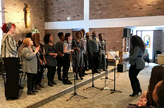 "Jazmyn Steele Gross leads the Abba Father Voices of Praise Community Gospel Choir in ""Ride on King Jesus"" at the University of Providence's Martin Luther King Jr. observation."