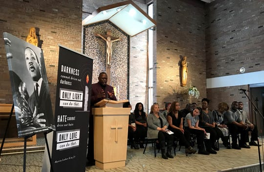"Pastor Kelvin Steele, Sr. of Abba Father Church of Faith implores the crowd at the University of Providence's Martin Luther King Jr. Day ceremony to embrace a brotherhood of humanity and understand ""that we're in this together."""