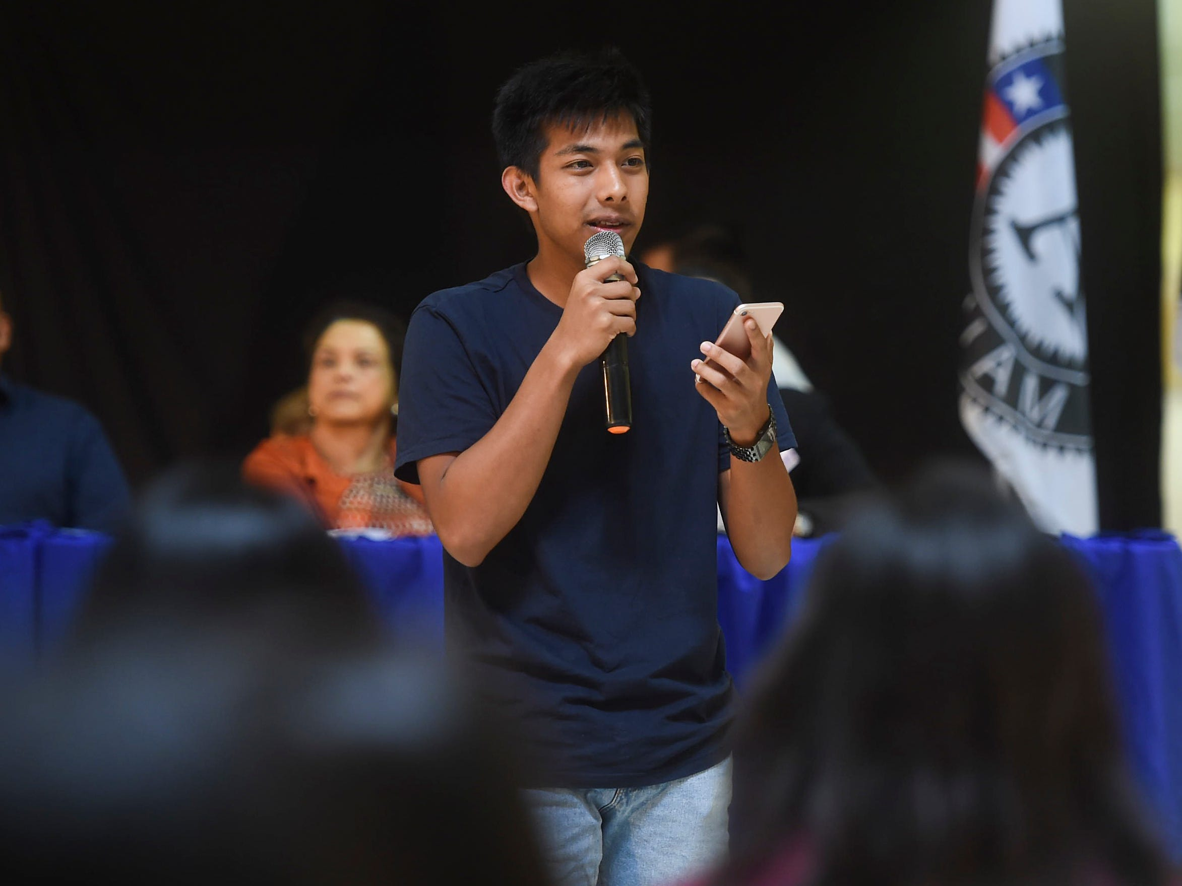 Luke Bukikosa, the George Washington High School Student Body Association vice president, recites a poem during the 2019 Martin Luther King Jr. Day of Service ceremony at the Agana Shopping Center, Jan. 21, 2019.