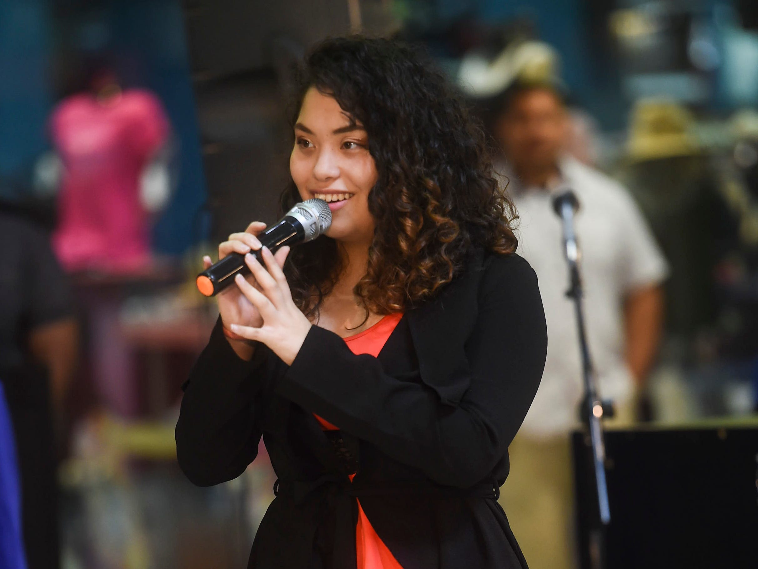 George Washington High School student Mariam Khuja performs a song during the 2019 Martin Luther King Jr. Day of Service ceremony at the Agana Shopping Center, Jan. 21, 2019.