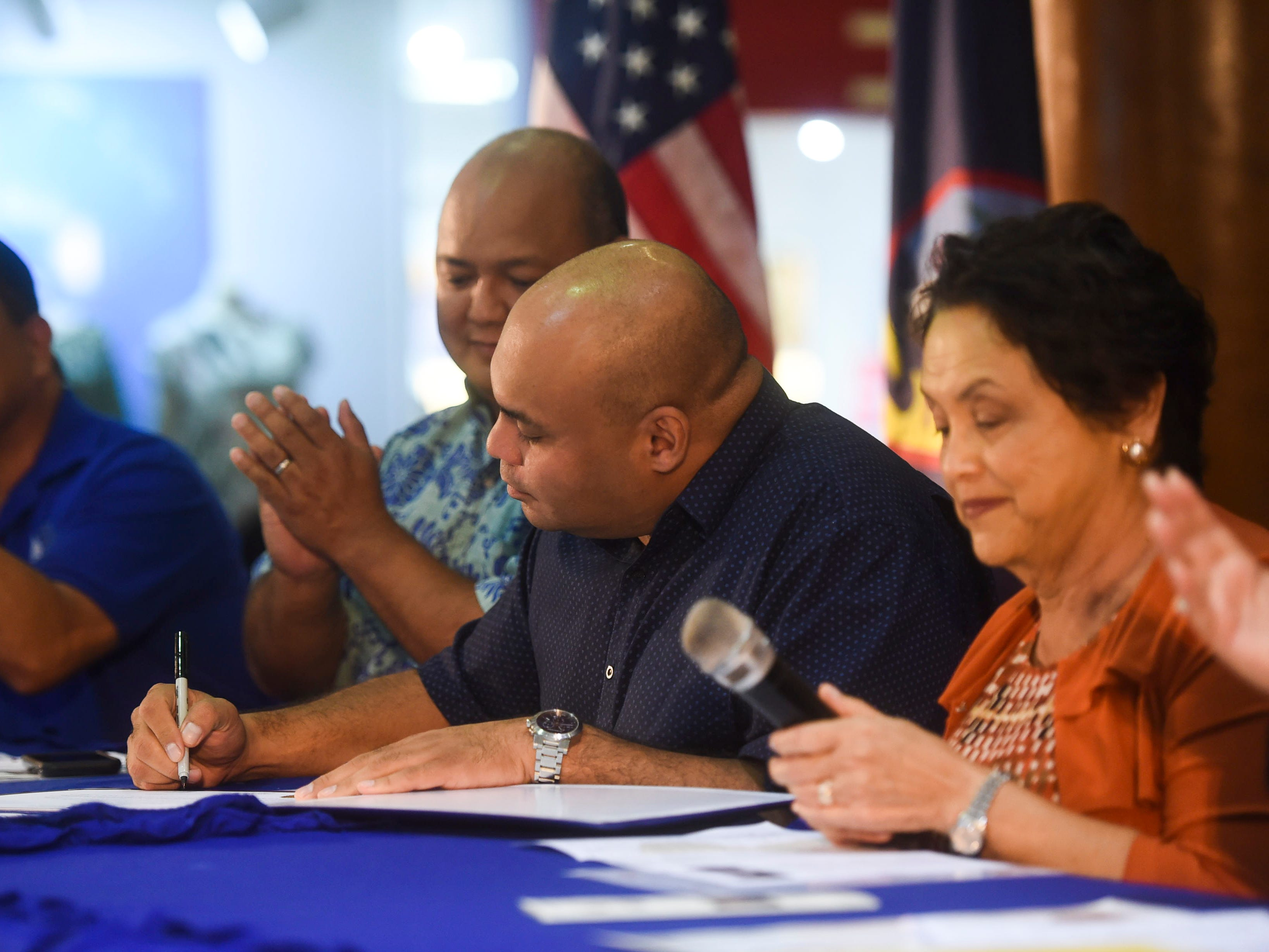 Lt. Gov. Josh Tenorio countersigns the 2019 Martin Luther King Jr. Day of Service Proclamation at the Agana Shopping Center, Jan. 21, 2019.