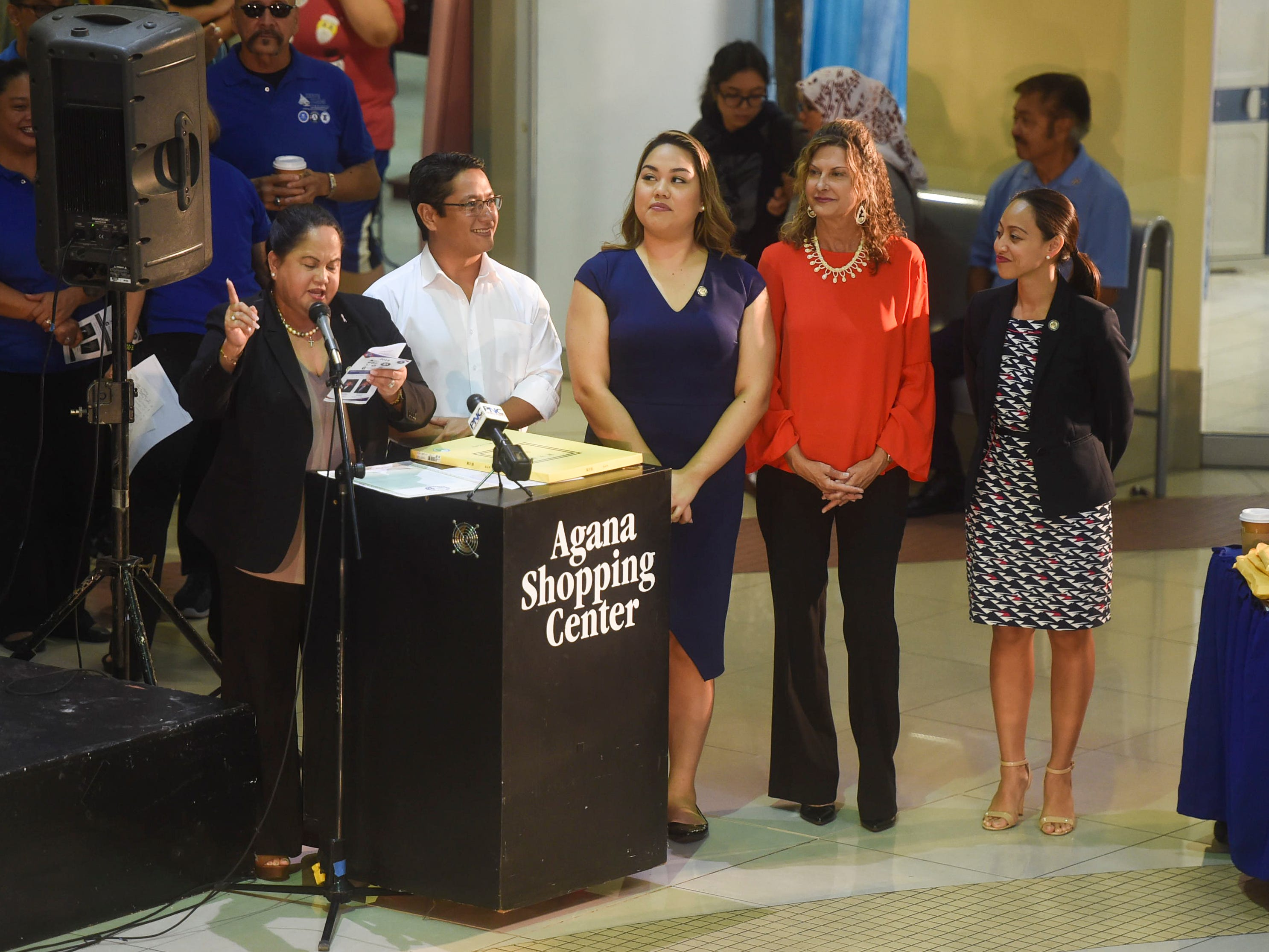 Members of the 35th Guam Legislature stand before a packed rotunda of college and high school volunteers to present Resolution 9-35 (COR) during the 2019 Martin Luther King Jr. Day of Service ceremony in the Agana Shopping Center, Jan. 21, 2019. From left: Speaker Tina Muna Barnes, Sen. Will Castro, Sen. Amanda Shelton, Sen. Kelly G. Marsh-Taitano, and Sen. Regine Biscoe Lee.