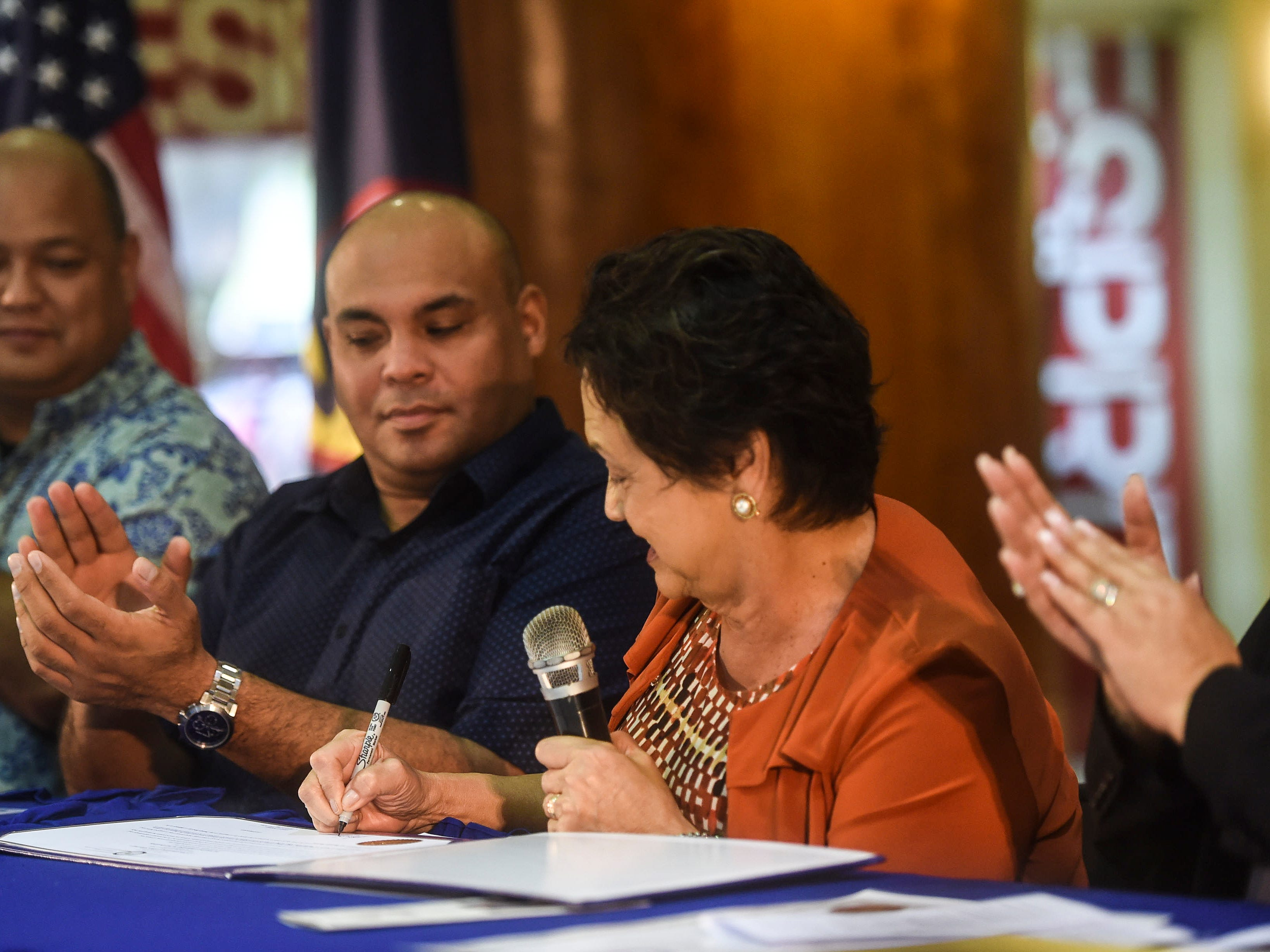 Gov. Lou Leon Guerrero signs the 2019 Martin Luther King Jr. Day of Service Proclamation at the Agana Shopping Center, Jan. 21, 2019.