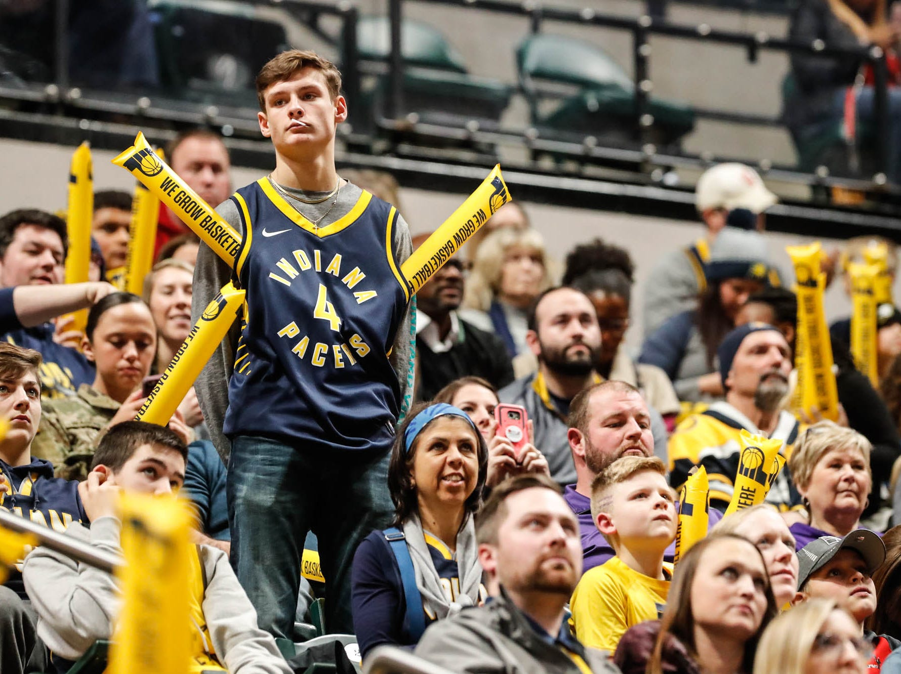 A fan gets creative with his noise makers during a game between the Pacers and Hornets at Bankers Life Fieldhouse on Sunday, Jan. 20, 2019.