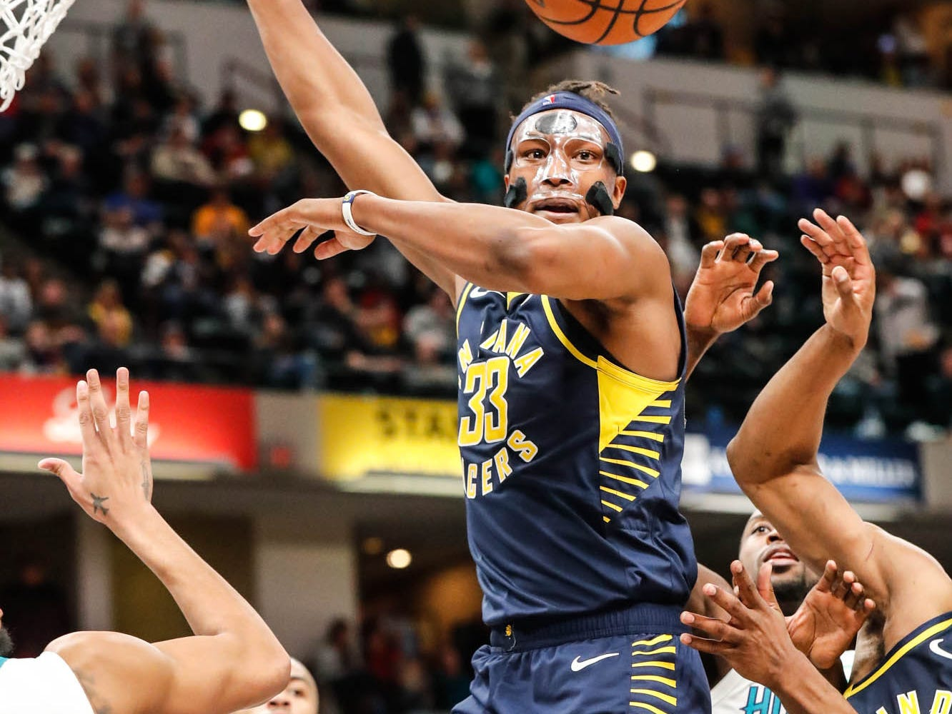 Indiana Pacers center Myles Turner (33), grabs for a rebound during a game between the Pacers and Hornets at Bankers Life Fieldhouse on Sunday, Jan. 20, 2019.