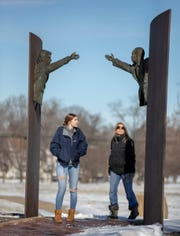 "Jenny Collins (left), Indianapolis, looks at the Landmark for Peace memorial sculpture in Dr. Martin Luther King Jr. Park with her daughter Alex Collins, 17, Jan. 21, 2019, Indianapolis, Monday, Jan. 21, 2019. . ""He's had such a big influence on us, there's no point in not coming out here to support him,"" Alex Collins said."