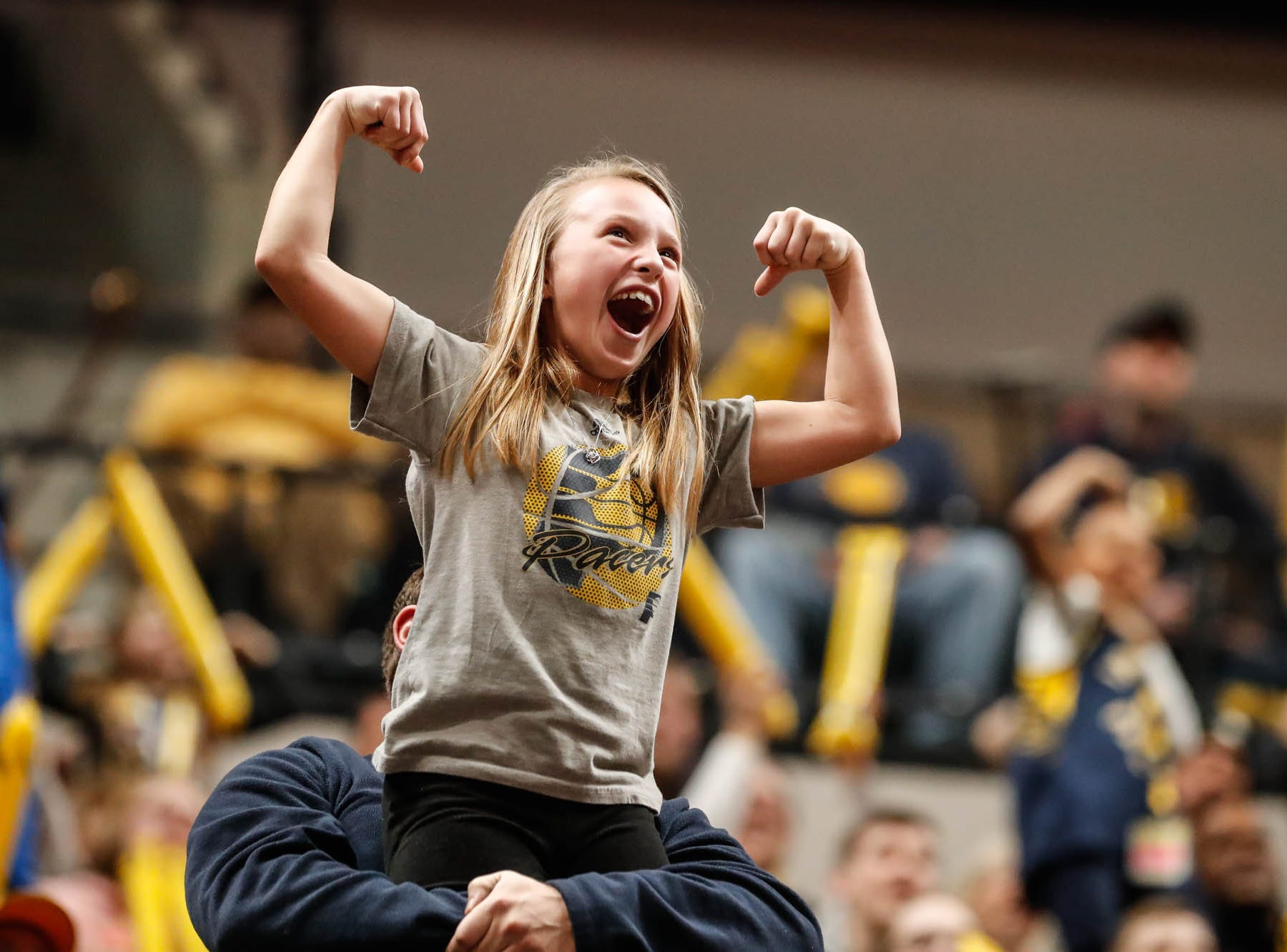 A young fan shows off her guns during a game between the Pacers and Hornets at Bankers Life Fieldhouse on Sunday, Jan. 20, 2019.