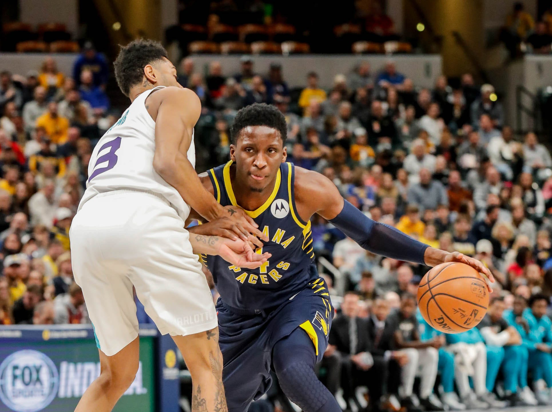 Indiana Pacers guard Victor Oladipo (4), dribbles past Charlotte Hornets guard Jeremy Lamb (3), during a game between the Pacers and Hornets at Bankers Life Fieldhouse on Sunday, Jan. 20, 2019.