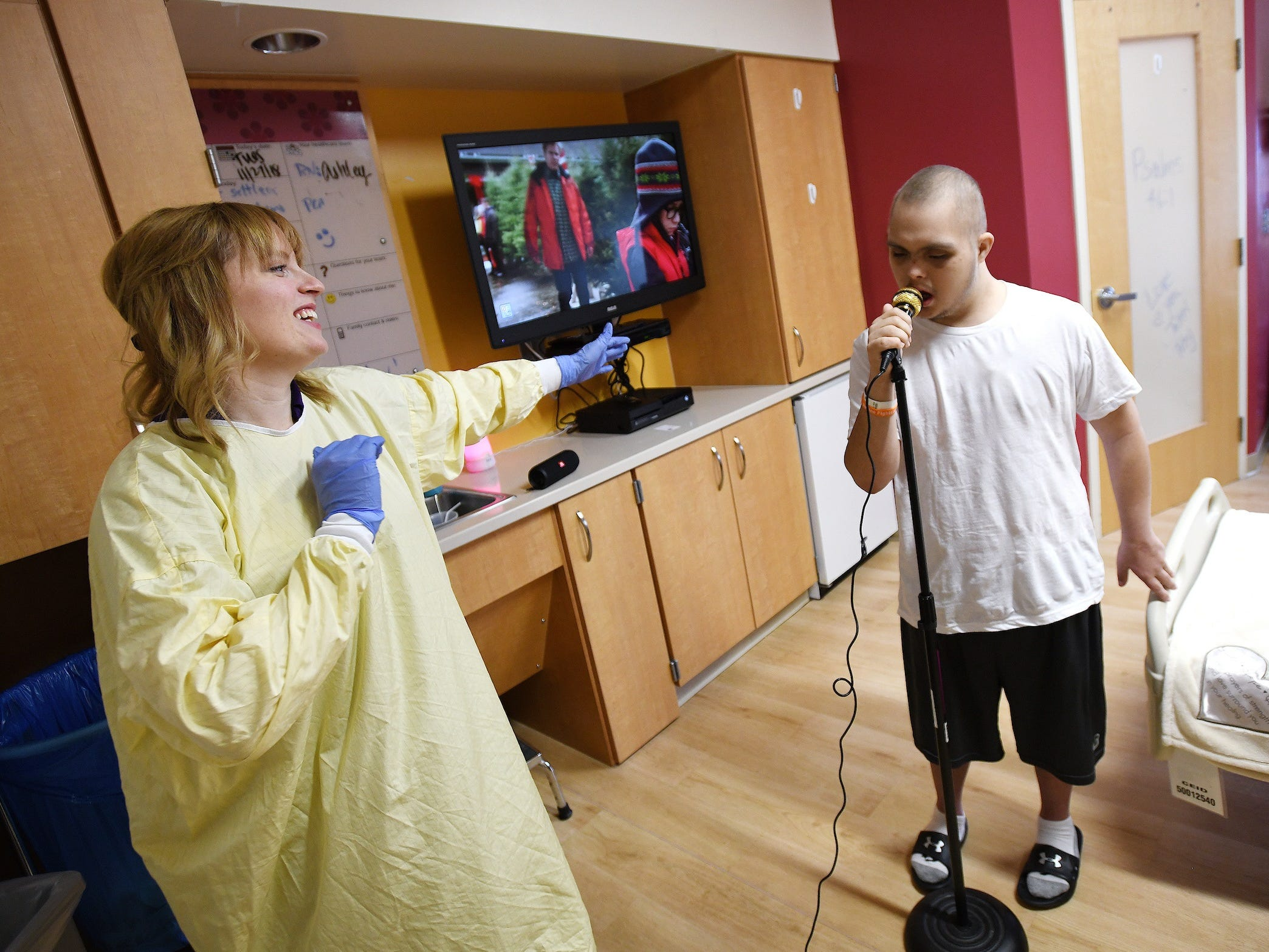 Jalen Brown, who is battling leukemia, is beloved at Riley Hospital for Children at IU Health. He loves singing and gets to often with music therapist Caitlin Krater.