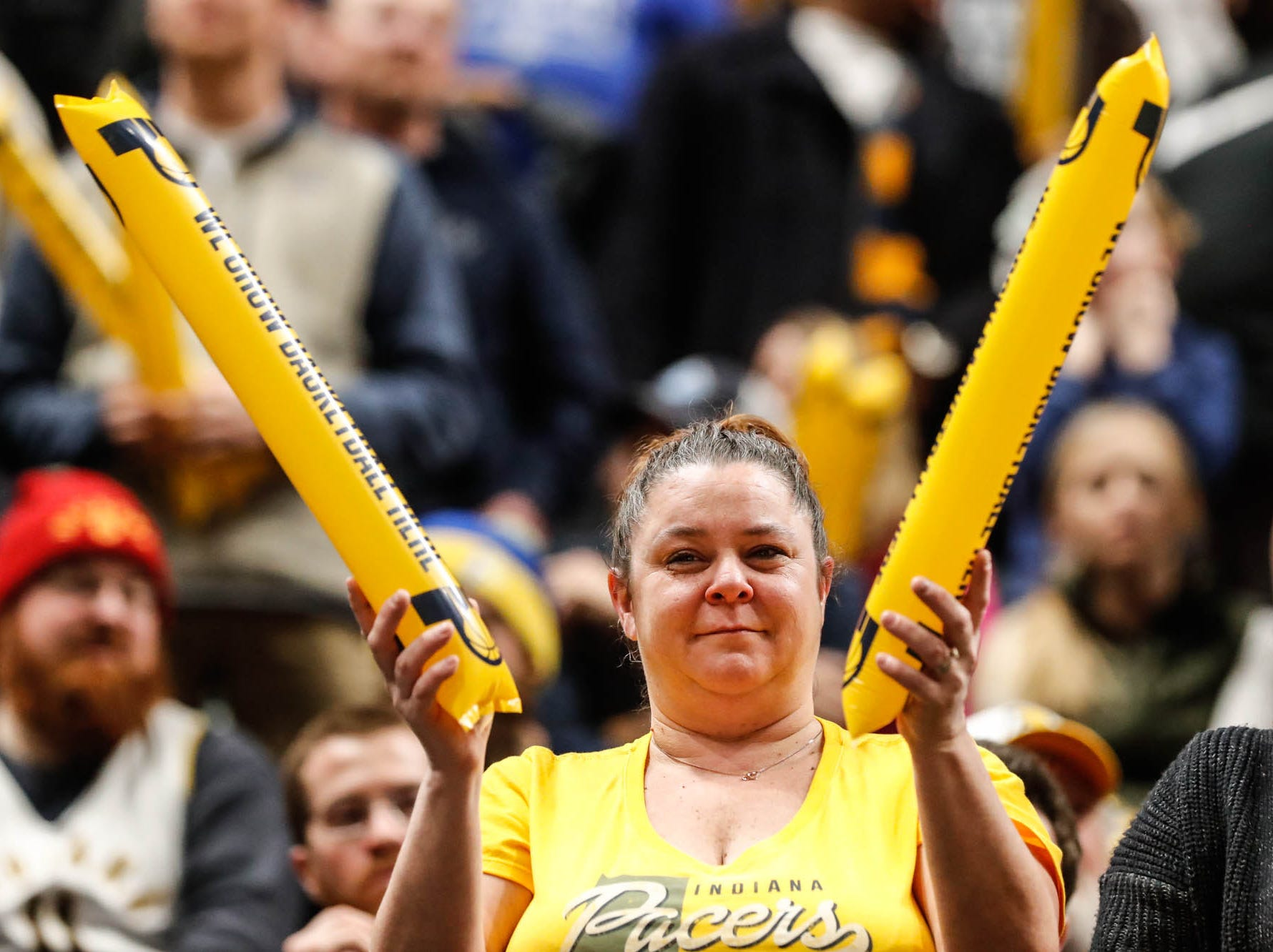 A fan attends a game between the Pacers and Hornets at Bankers Life Fieldhouse on Sunday, Jan. 20, 2019.