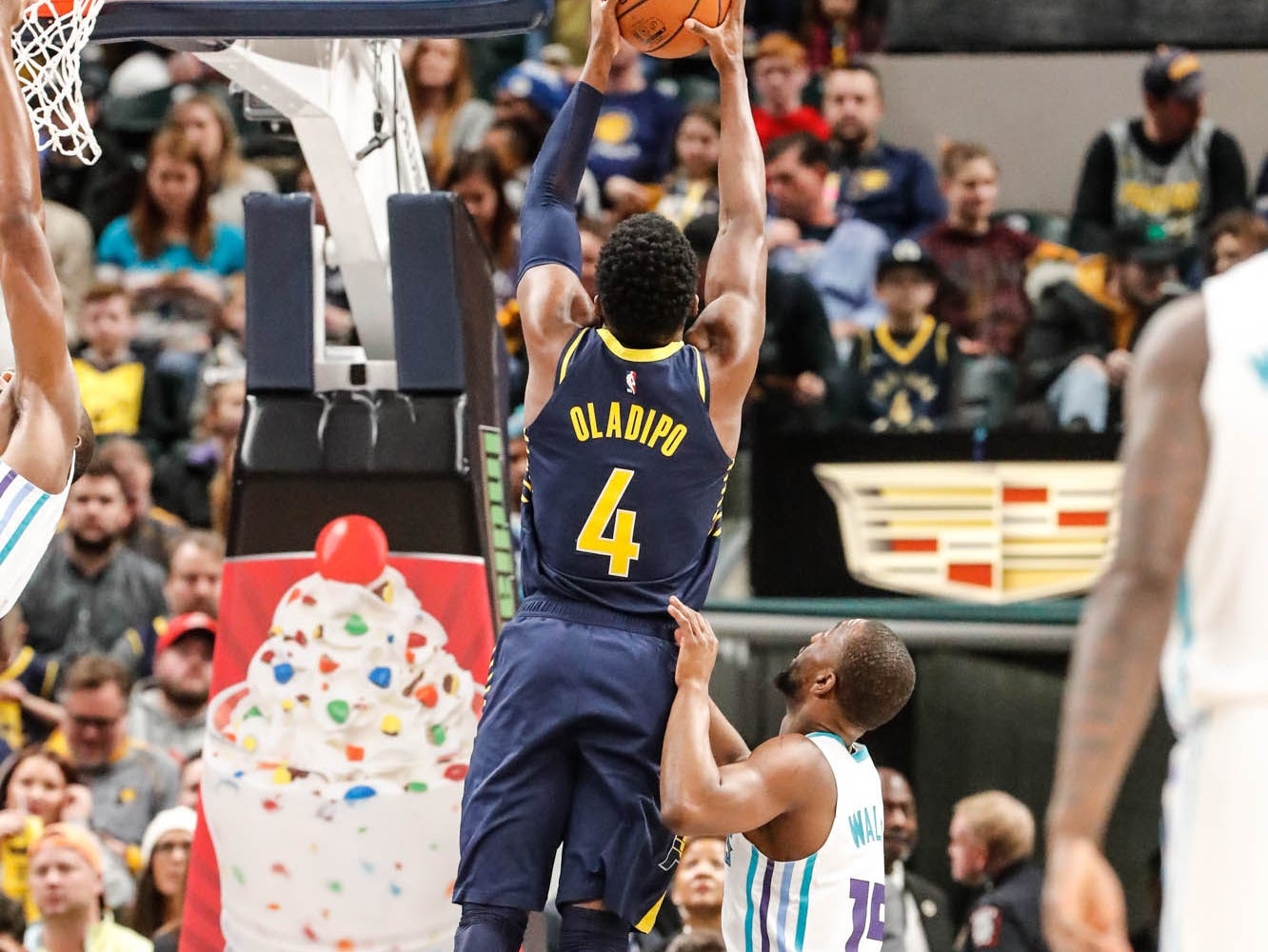 Indiana Pacers guard Victor Oladipo (4), grabs a rebound from Charlotte Hornets guard Kemba Walker (15), during a game between the Pacers and Hornets at Bankers Life Fieldhouse on Sunday, Jan. 20, 2019.
