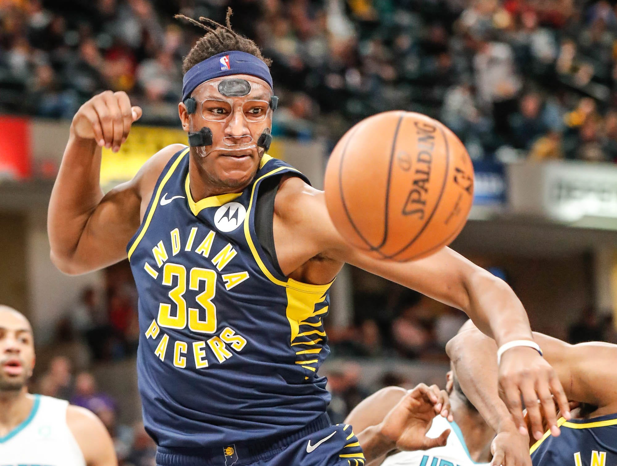 Indiana Pacers center Myles Turner (33), grabs for a loose ball during a game between the Pacers and Hornets at Bankers Life Fieldhouse on Sunday, Jan. 20, 2019.