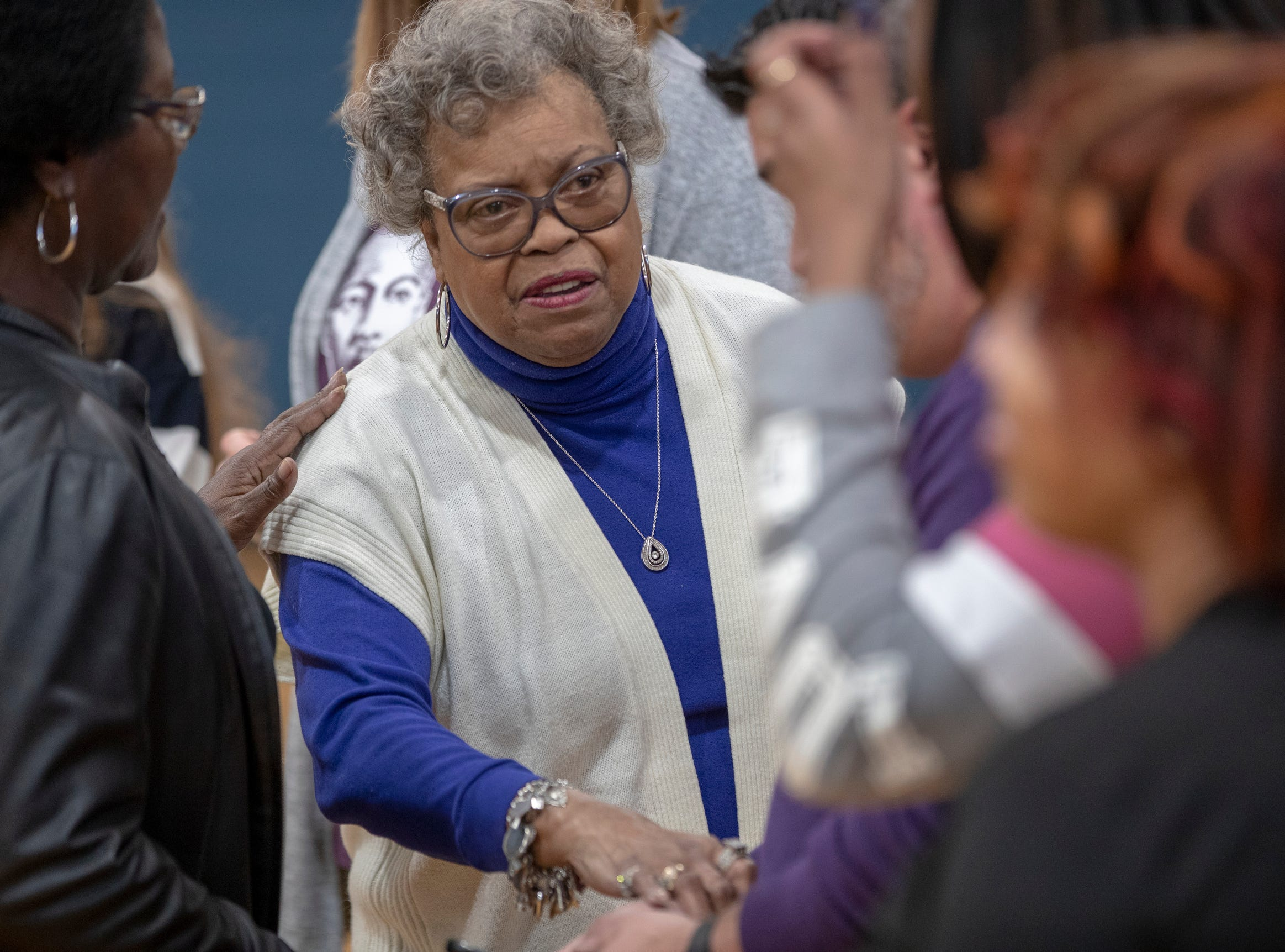 Frankie Casel, President of the Friends of Douglass, shakes a hand as she attends the day's dedication of the remodel of Frederick Douglass Park, Indianapolis, Monday, Jan. 21, 2019.