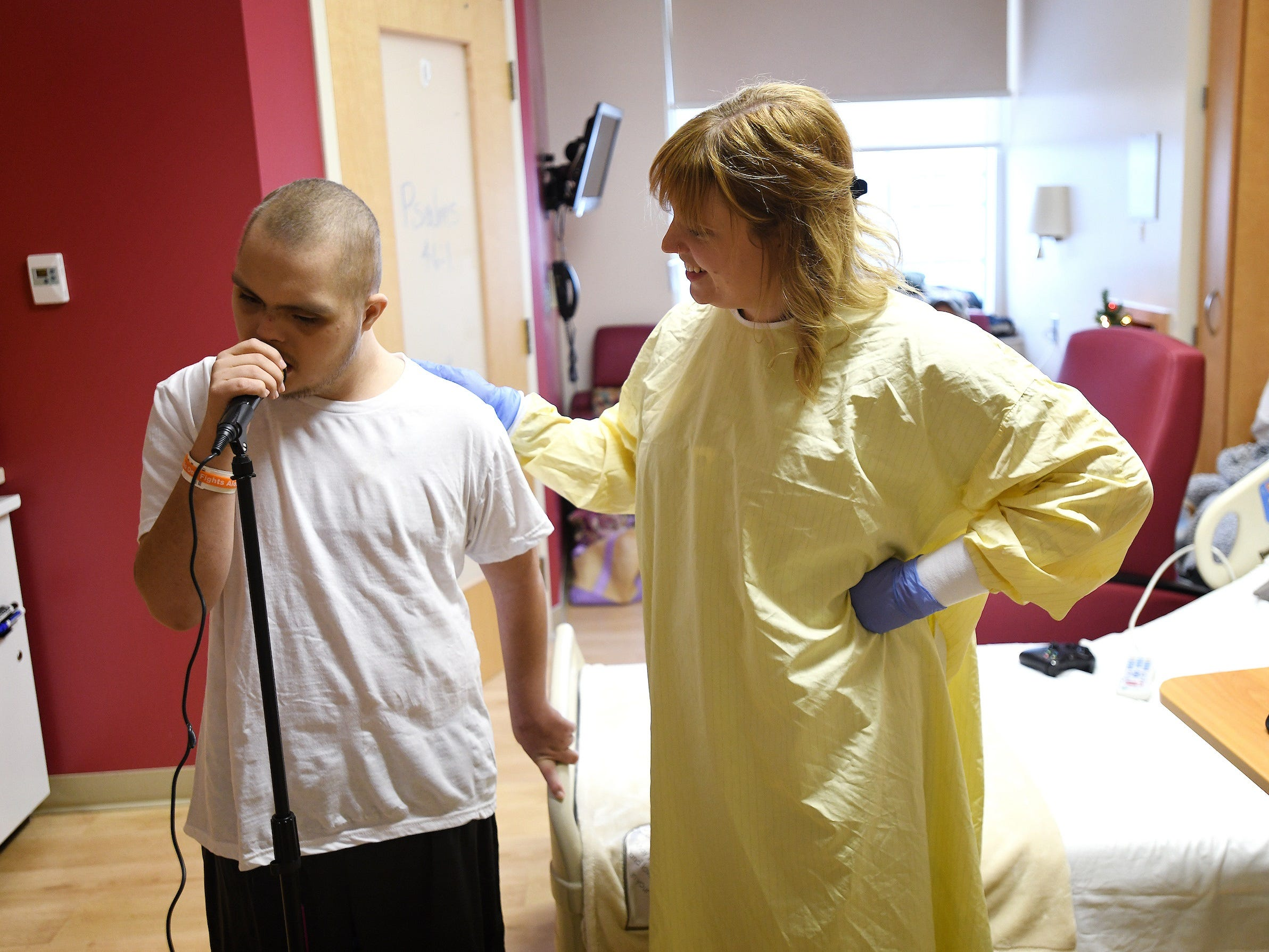 Music therapist Caitlin Krater works with Jalen Brown at Riley Hospital for Children at IU Health, where he is being treated for leukemia.
