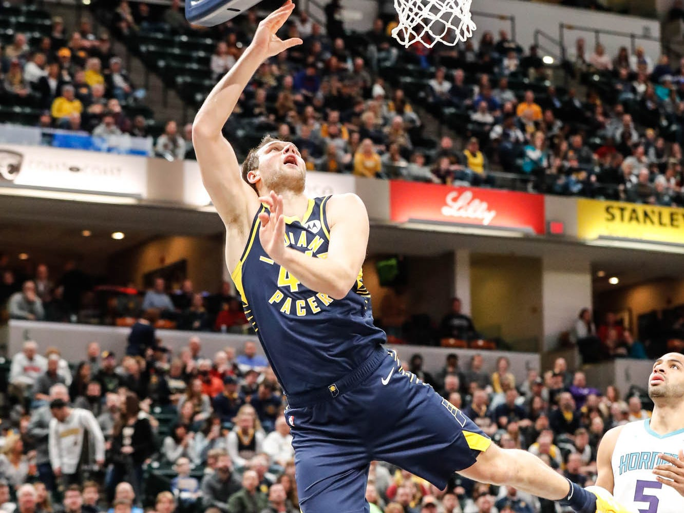 Indiana Pacers forward Bojan Bogdanovic (44), shoots a layup during a game between the Pacers and Hornets at Bankers Life Fieldhouse on Sunday, Jan. 20, 2019.