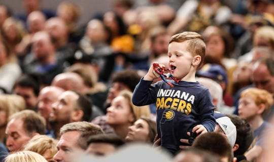 A young fan attends the game between the Pacers and Hornets with Spiderman at Bankers Life Fieldhouse on Sunday, Jan. 20, 2019.