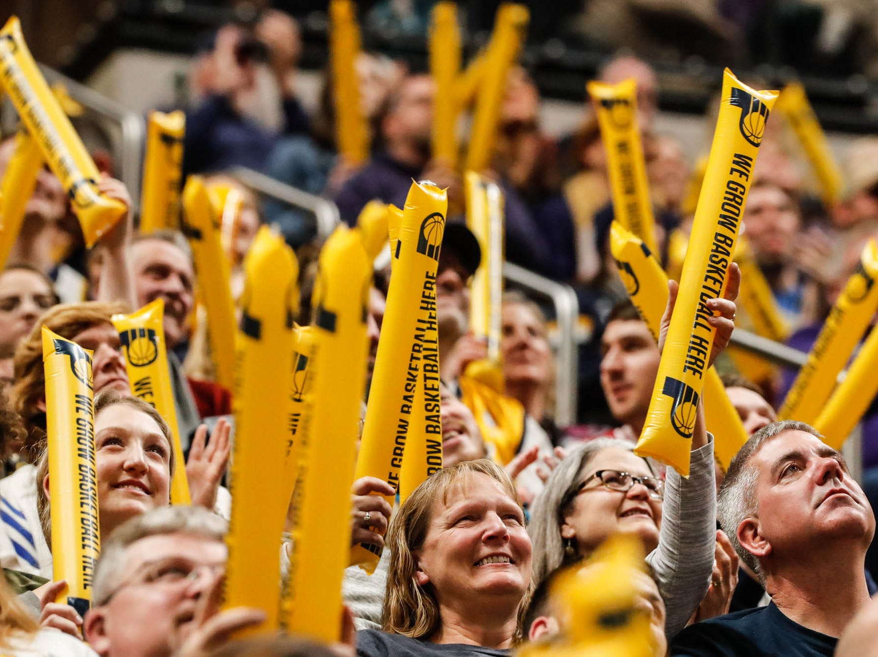 Fans wave their boom sticks during a game between the Pacers and Hornets at Bankers Life Fieldhouse on Sunday, Jan. 20, 2019.