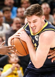 Indiana Pacers forward T.J. Leaf (22)protects the ball during a game between the Pacers and Hornets at Bankers Life Fieldhouse on Sunday, Jan. 20, 2019.