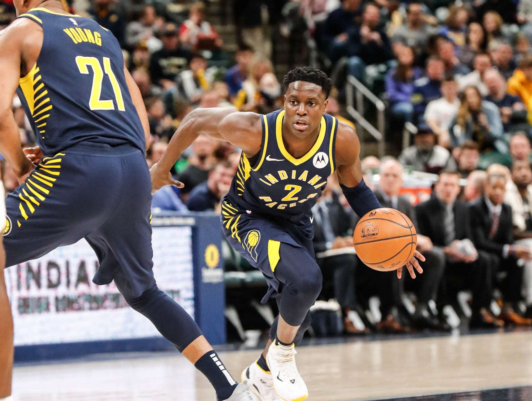 Indiana Pacers guard Darren Collison (2) dribbles around team mate Indiana Pacers forward Thaddeus Young (21), during a game between the Pacers and Hornets at Bankers Life Fieldhouse on Sunday, Jan. 20, 2019.