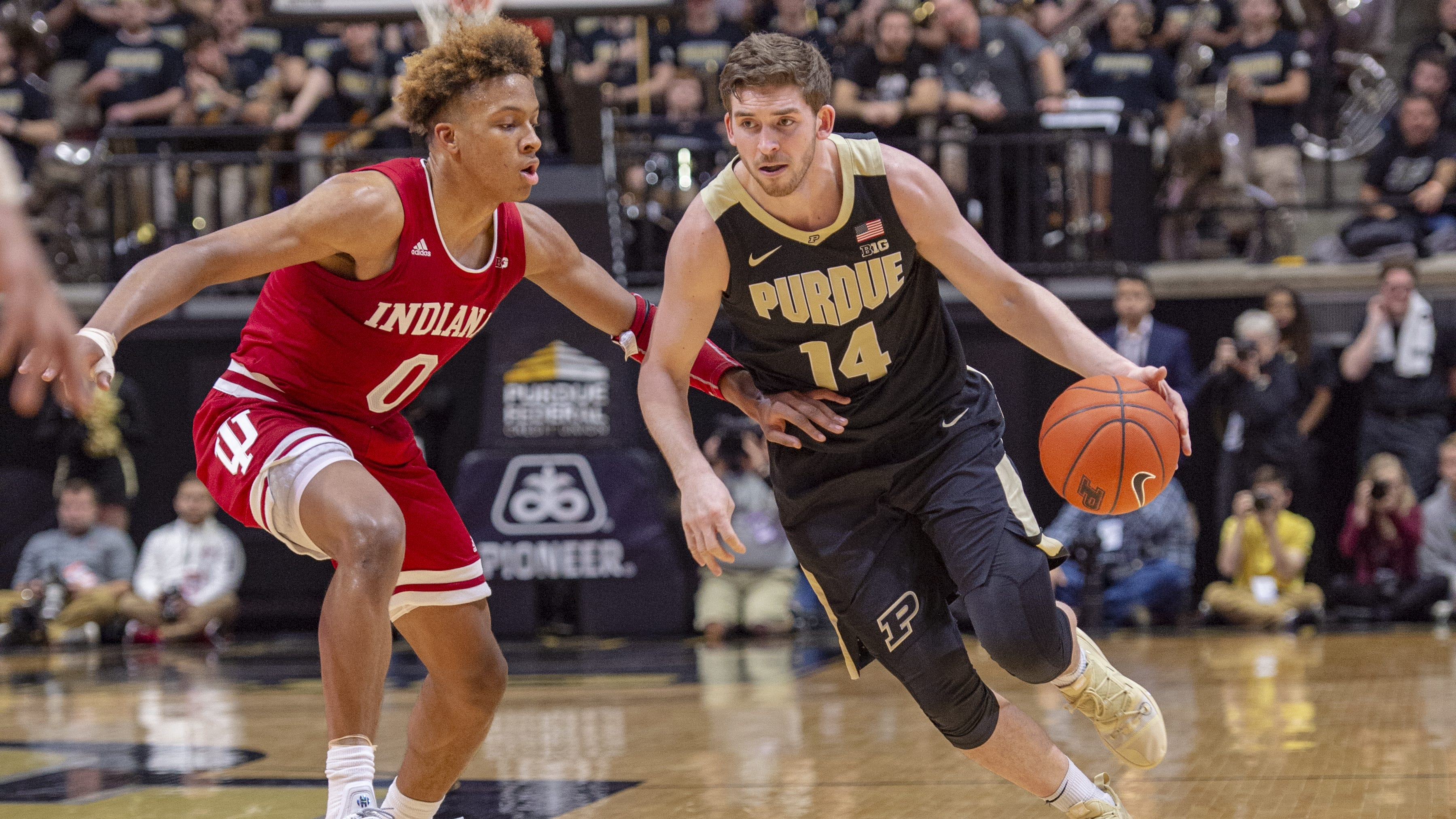 Purdue Boilermakers guard Ryan Cline (14) makes a move around the defense of Indiana Hoosiers guard Romeo Langford (0) during the second half of action. Purdue hosted Indiana in a BigTen men's basketball matchup, Saturday, Jan. 19, 2019. Purdue won 70-55.