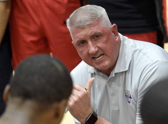 Center Hill head coach Newton Mealer talks to the Mustangs during a time out on Monday, January 21, 2019, at the Rumble in the South high school basketball tournament at St. Andrew's Episcopal School in Ridgeland, Miss.