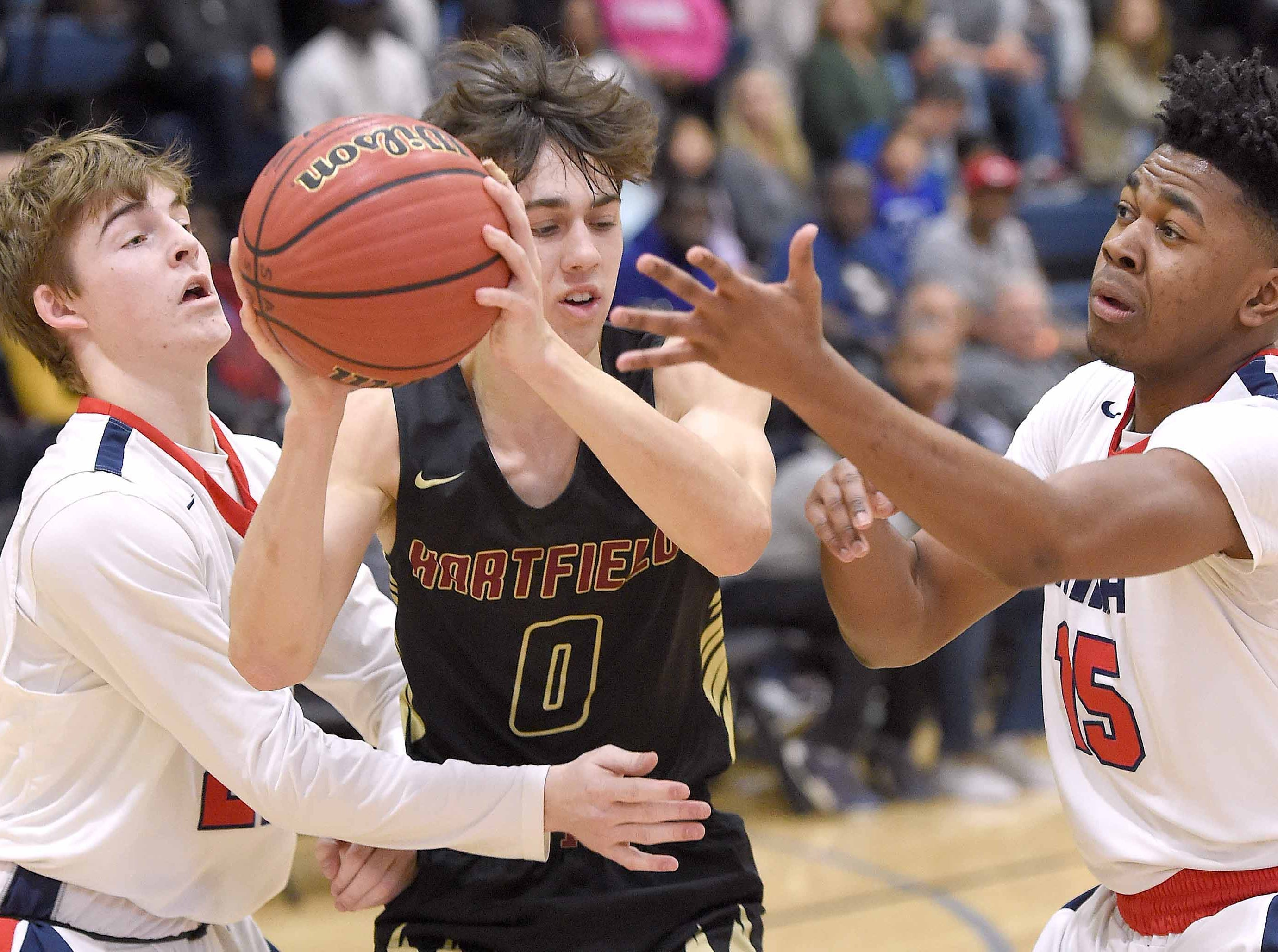 Hartfield's Hill Savell (0) is double teamed by two MRA defenders including Ryan Kitchens (15) on Monday, January 21, 2019, at the Rumble in the South high school basketball tournament at St. Andrew's Episcopal School in Ridgeland, Miss.