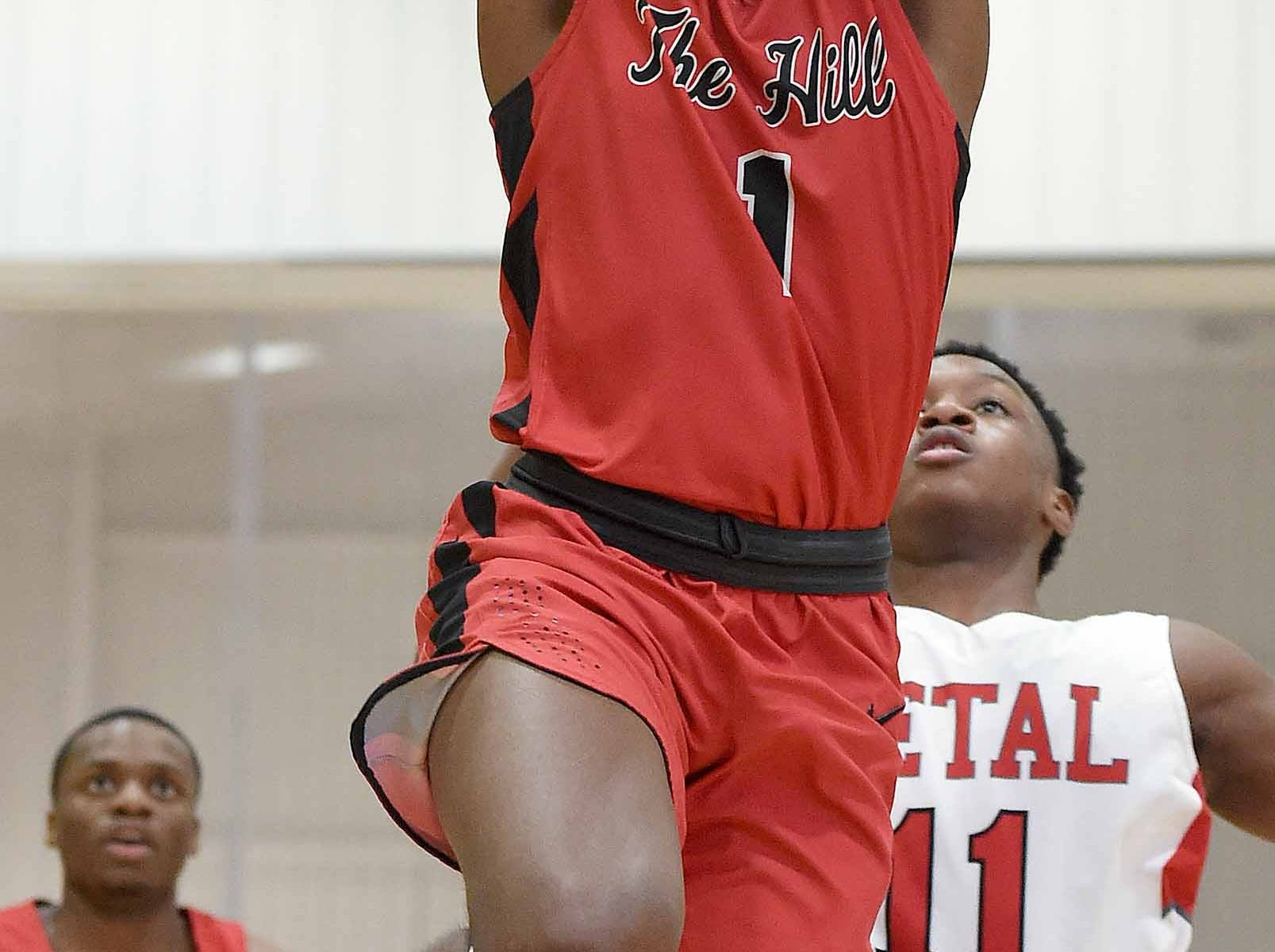 Petal's Caleb McGill (1) goes up for a dunk against Center Hill on Monday, January 21, 2019, at the Rumble in the South high school basketball tournament at St. Andrew's Episcopal School in Ridgeland, Miss.