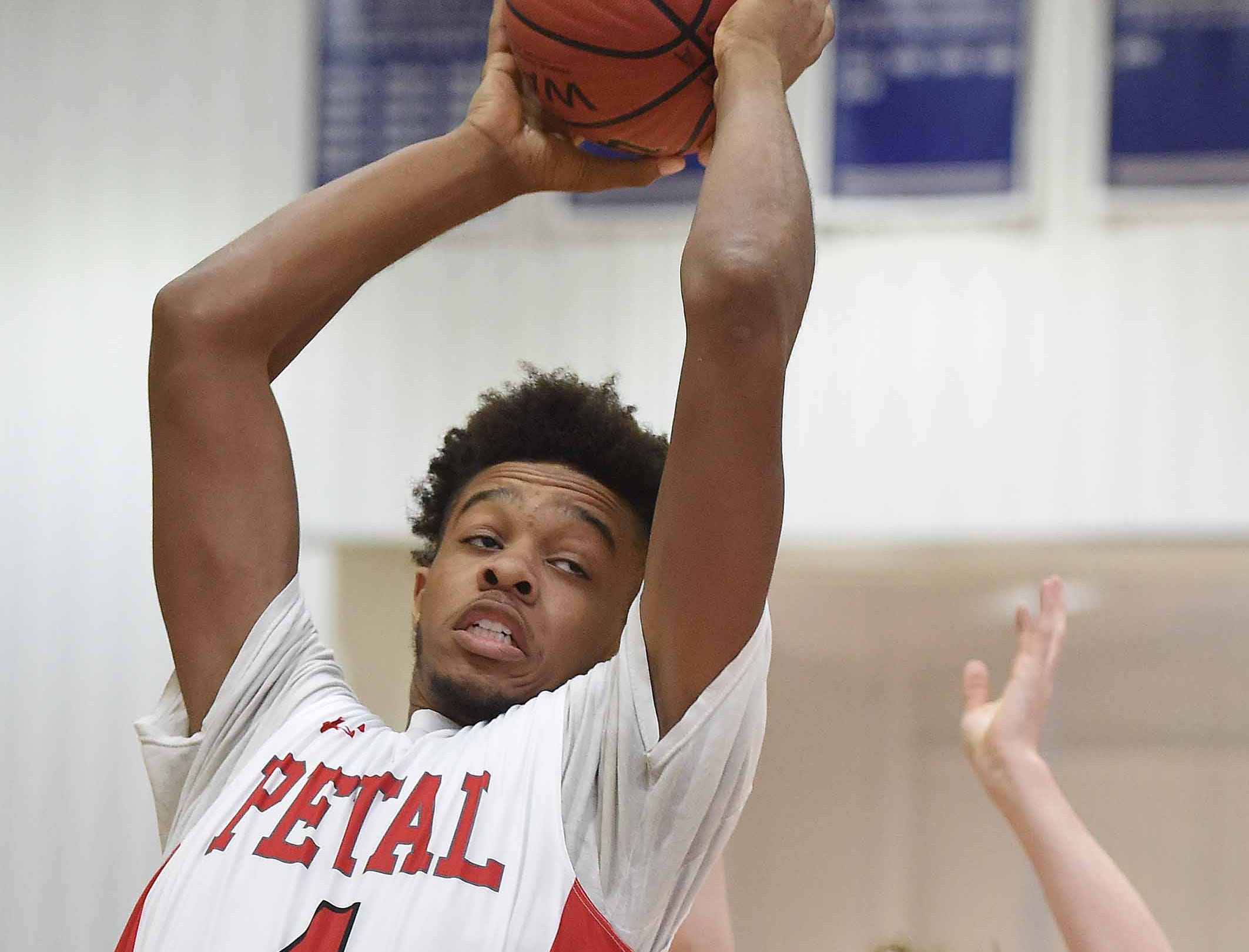 Petal's Treylan Smith (4) rebounds against Center Hill on Monday, January 21, 2019, at the Rumble in the South high school basketball tournament at St. Andrew's Episcopal School in Ridgeland, Miss.