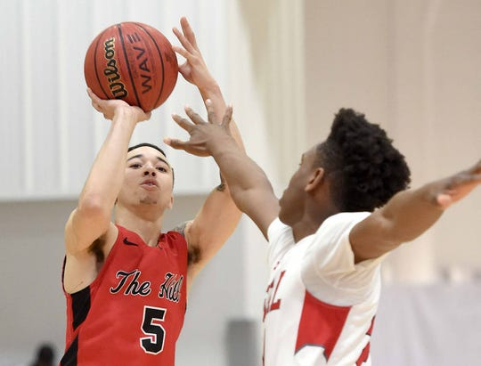Center Hill's Calvin Temple (5) shoots a three pointer over a Petal defender on Monday, January 21, 2019, at the Rumble in the South high school basketball tournament at St. Andrew's Episcopal School in Ridgeland, Miss.