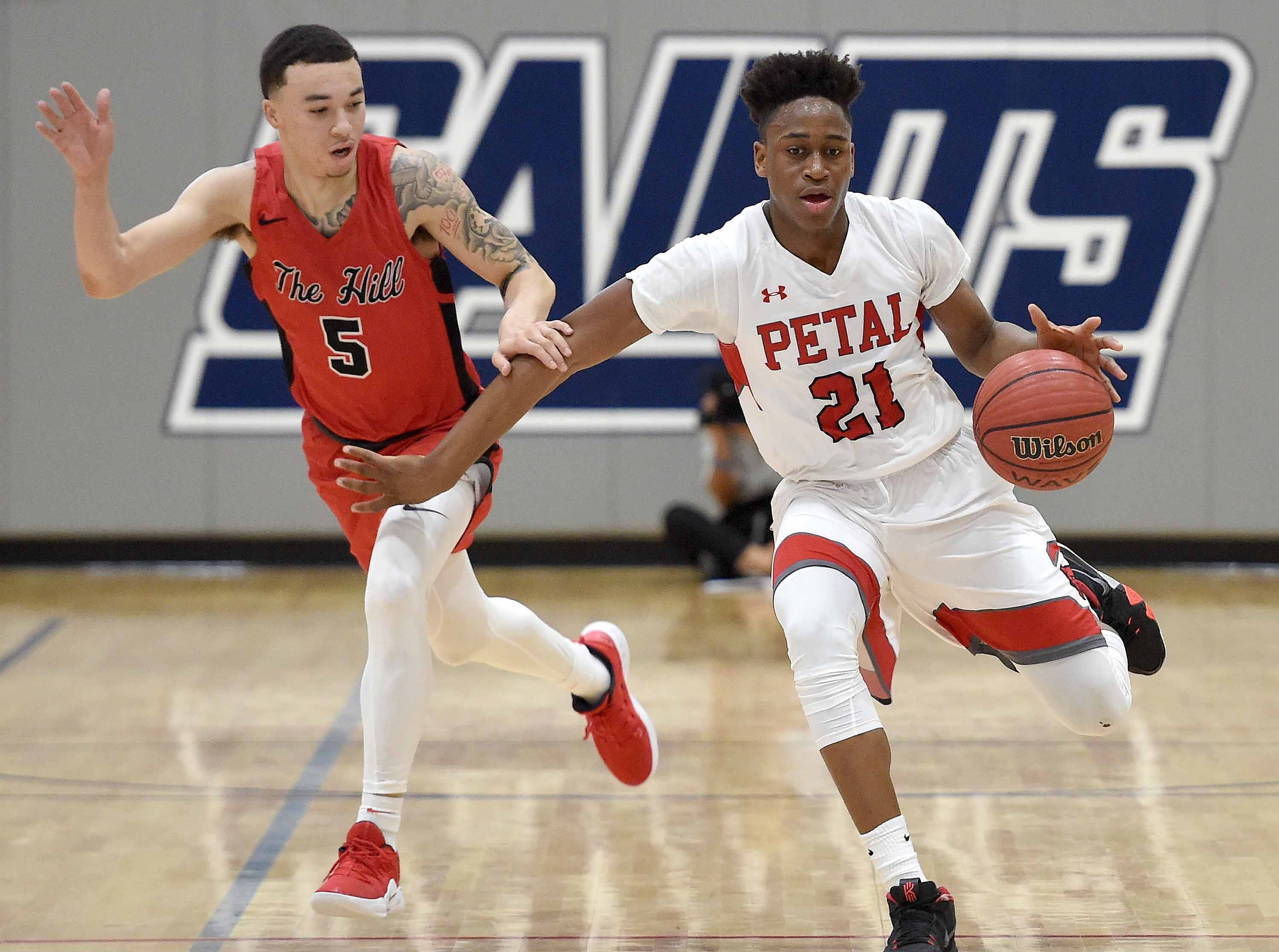 Petal's Don Avila (21) brings the ball up against Center Hill's Calvin Temple (5) on Monday, January 21, 2019, at the Rumble in the South high school basketball tournament at St. Andrew's Episcopal School in Ridgeland, Miss.