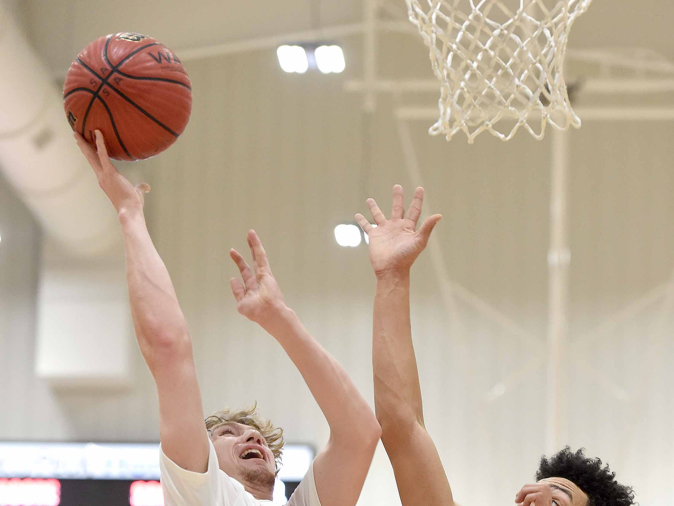 Petal's Landyn Shows (23) shoots over Center Hill's Kaeden Laws (24) on Monday, January 21, 2019, at the Rumble in the South high school basketball tournament at St. Andrew's Episcopal School in Ridgeland, Miss.