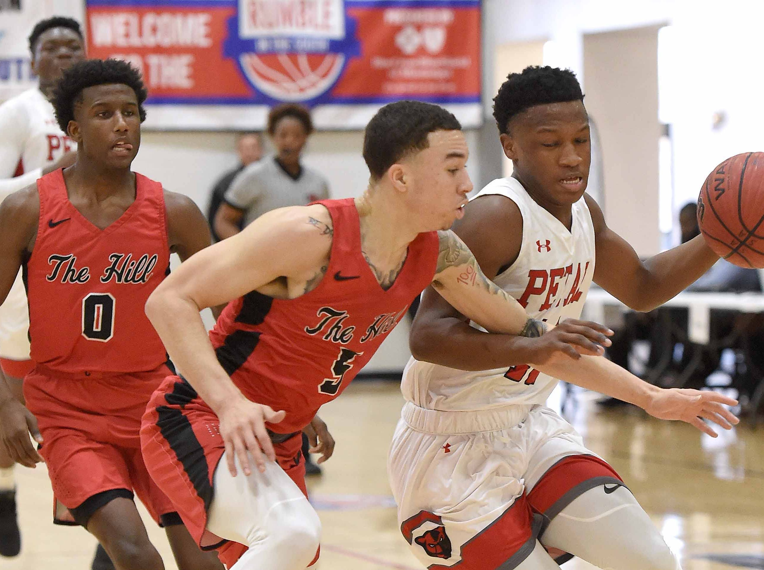 Petal's Anthony Henderson (right) brings the ball up the court against Center Hill's Calvin Temple (5) on Monday, January 21, 2019, at the Rumble in the South high school basketball tournament at St. Andrew's Episcopal School in Ridgeland, Miss.