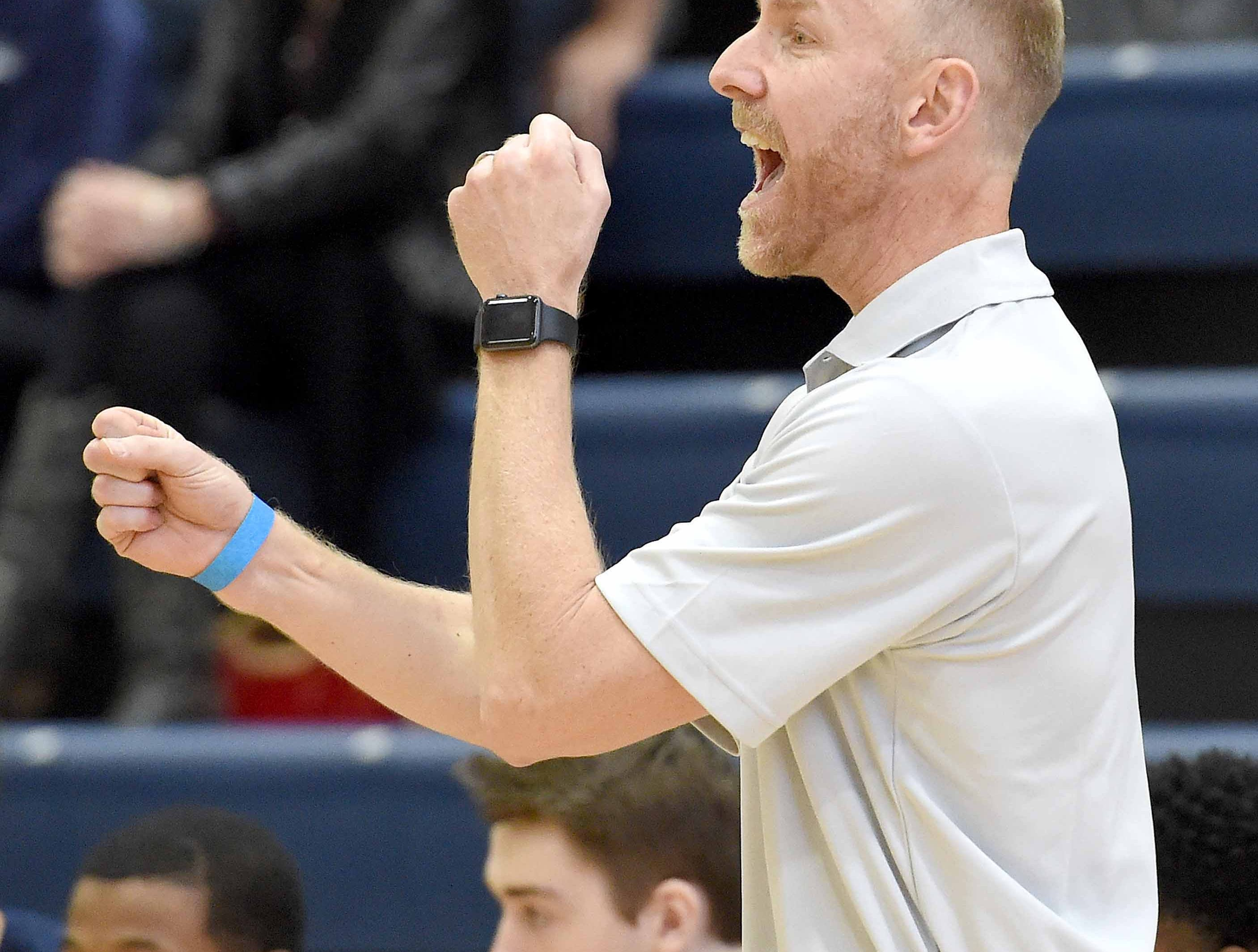 Jackson Academy head coach Josh Brooks calls out to the Raiders on Monday, January 21, 2019, at the Rumble in the South high school basketball tournament at St. Andrew's Episcopal School in Ridgeland, Miss.