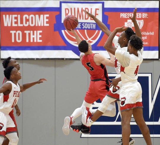 Center Hill's Calvin Temple (5) drives the lane against Petal on Monday, January 21, 2019, at the Rumble in the South high school basketball tournament at St. Andrew's Episcopal School in Ridgeland, Miss.