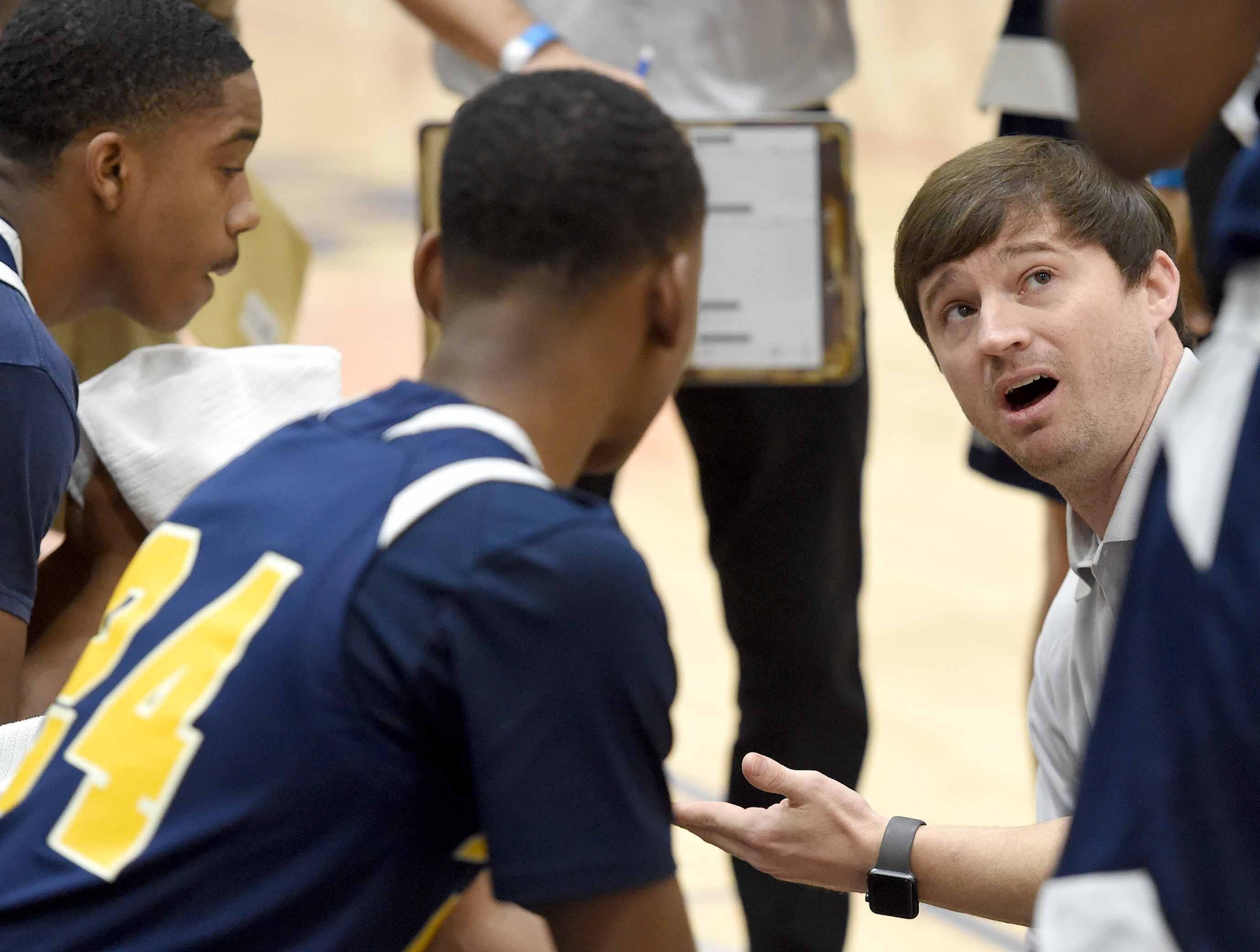 St. Joseph head coach Michael Howell talks to the Bruins during a time out on Monday, January 21, 2019, at the Rumble in the South high school basketball tournament at St. Andrew's Episcopal School in Ridgeland, Miss.