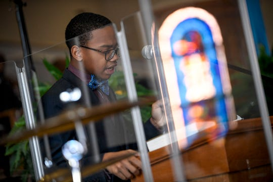 """Jah'Karious Conley, a sophomore at Madison Academic High School, recites the """"I Have a Dream"""" speech during a service held for Martin Luther King Jr. Day at Mt. Zion Baptist Church in Jackson, Tenn., on Monday, Jan. 21, 2019."""