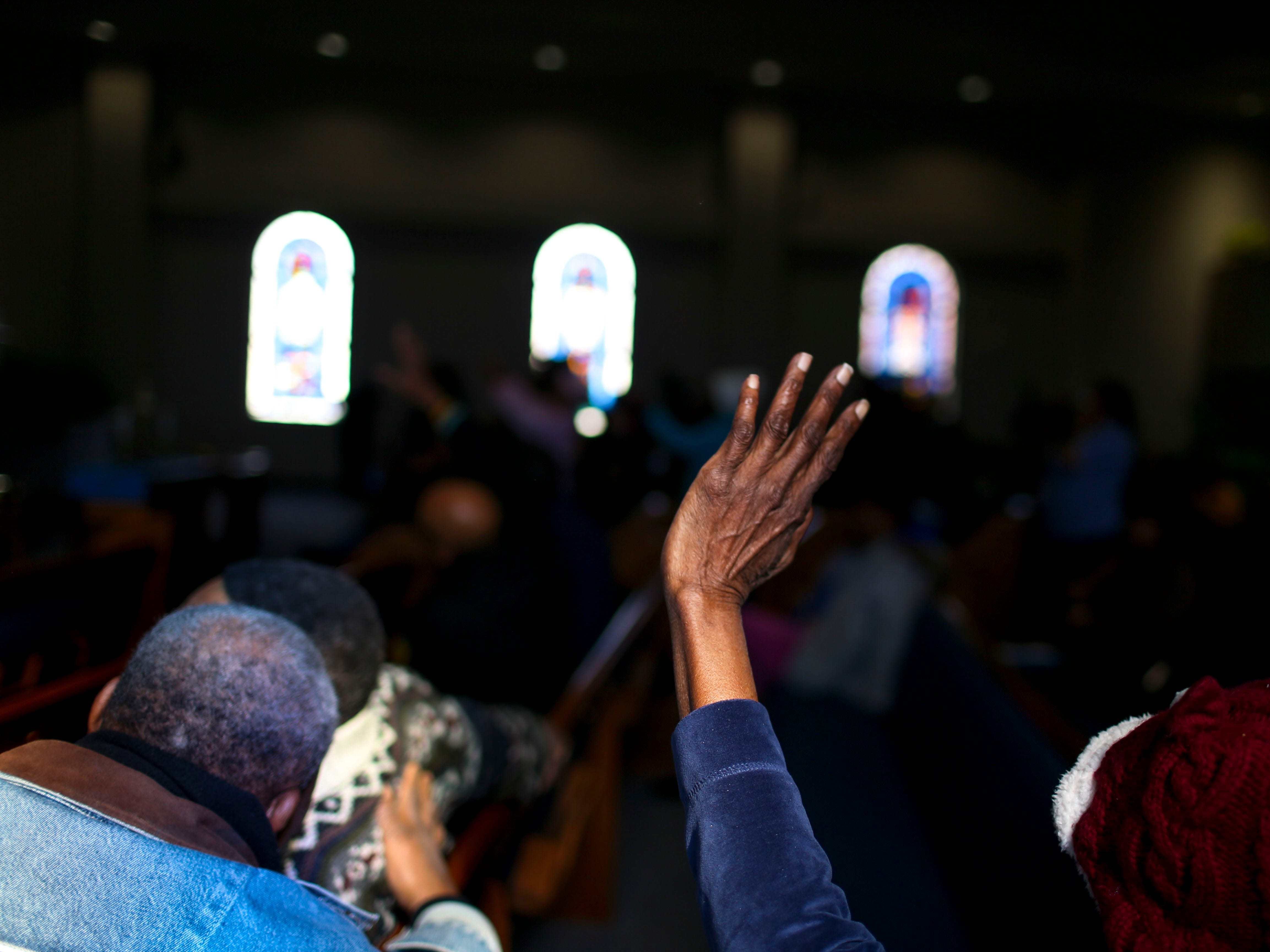 Ophelia Bond raises her hand in praise while Rev. Cleavon Meabon sings during a service held for Martin Luther King Jr. Day at Mt. Zion Baptist Church in Jackson, Tenn., on Monday, Jan. 21, 2019.