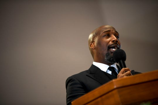 Rev. William Watson speaks during a service held for Martin Luther King Jr. Day at Mt. Zion Baptist Church in Jackson, Tenn., on Monday, Jan. 21, 2019.