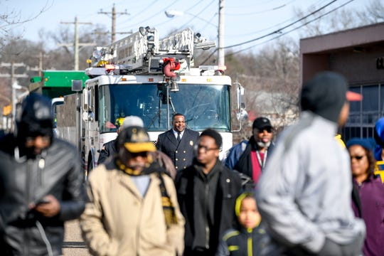 Madison County Fire follows up the main party of paraders with an engine during the lineup before a march through downtown Jackson to Mt. Zion Baptist Church at T.R. White Sportsplex in Jackson, Tenn., on Monday, Jan. 21, 2019.