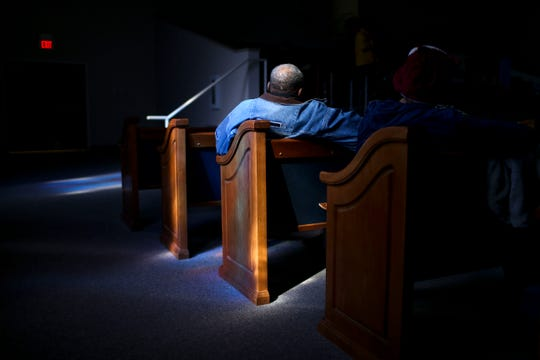 James Hunt leans back in a church pew amidst the sun rays through a stain glass window while listening to speakers during a service held for Martin Luther King Jr. Day at Mt. Zion Baptist Church in Jackson, Tenn., on Monday, Jan. 21, 2019.
