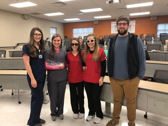 During the Nursing Day at UT Martin Parsons Center, HOSA students from four surrounding high schools get hands-on experience with nursing skills. Pictured, from left to right, are Mallory Clenney, a second-year nursing student; Ivy Roberts, a senior at Hardin County High School; Ally Bland, a junior at Lexington High School; Hadley Bray, a senior at Lexington High School; and Jacob French, a second-year nursing student. Roberts' arm is wrapped to showcase impaired mobility and Bland and Bray wear shades that impair vision.