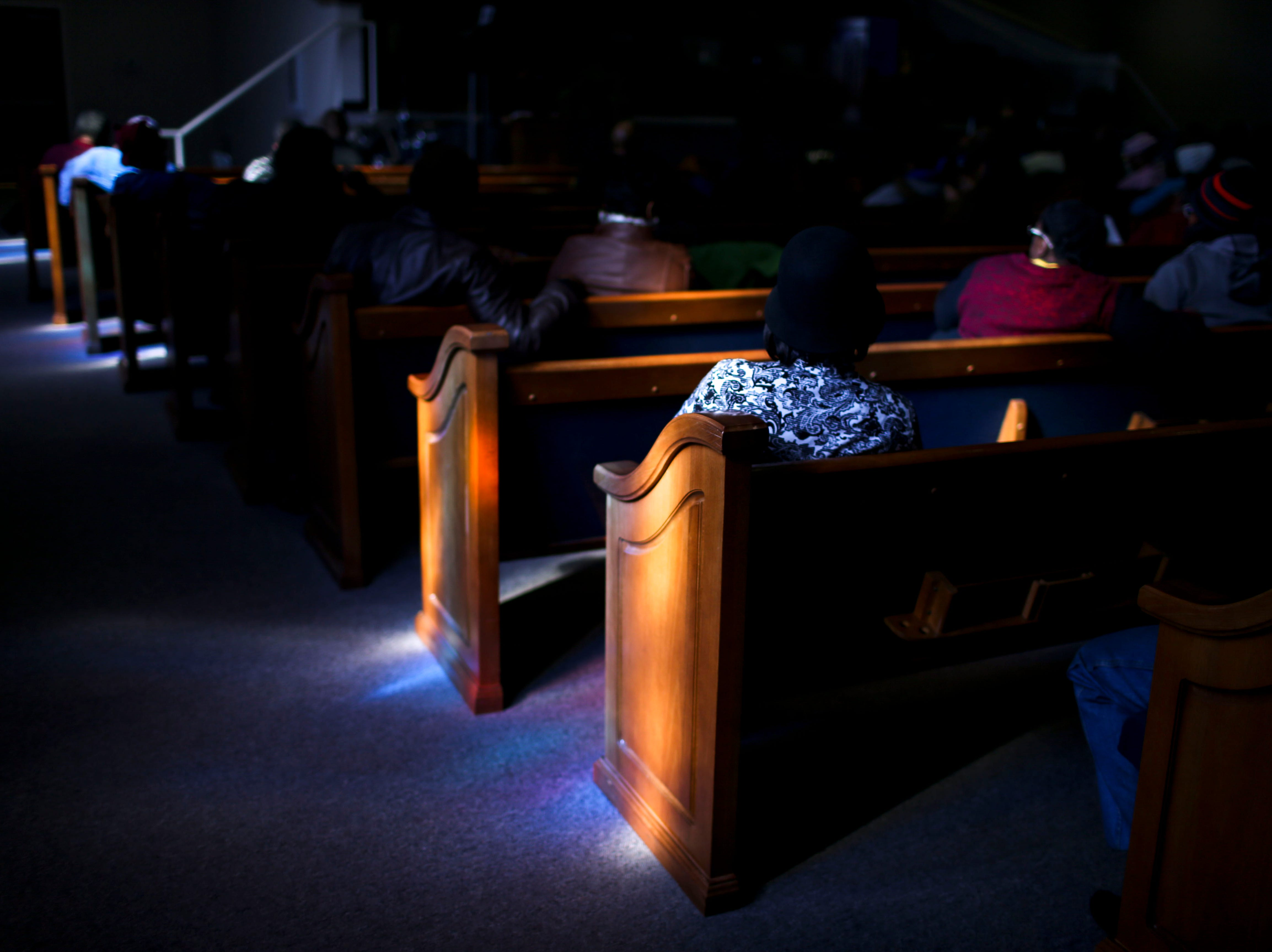 Lovett Brooks sits in a church pew and listens to speakers during a service held for Martin Luther King Jr. Day at Mt. Zion Baptist Church in Jackson, Tenn., on Monday, Jan. 21, 2019.