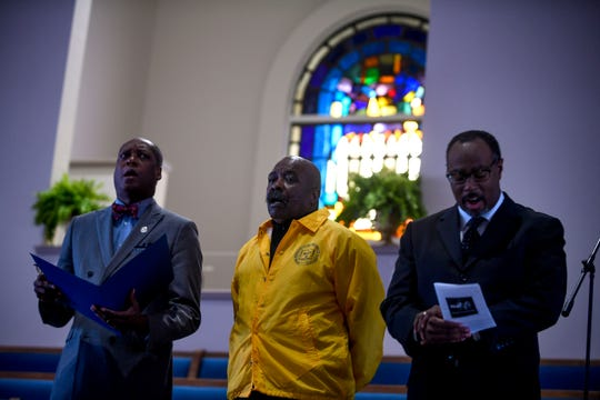 City councilman Ernest Brooks, left, NAACP president Harrell Carter, center, and Pastor Curtis Mormon sing with Rev. Cleavon Meabon during a service held for Martin Luther King Jr. Day at Mt. Zion Baptist Church in Jackson, Tenn., on Monday, Jan. 21, 2019.