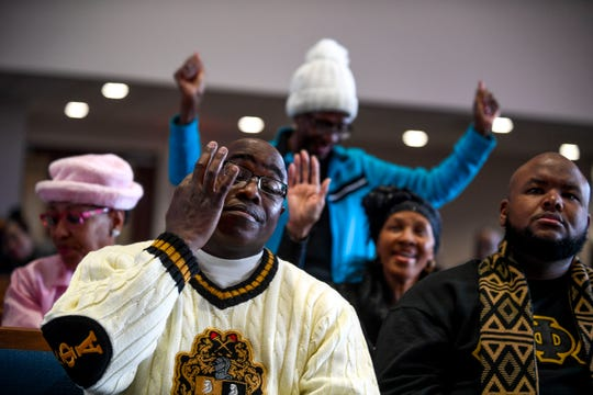 Marshall Banks wipes a tear from his eye while crowd members surrounding him celebrate as Rev. William Watson speaks during a service held for Martin Luther King Jr. Day at Mt. Zion Baptist Church in Jackson, Tenn., on Monday, Jan. 21, 2019.