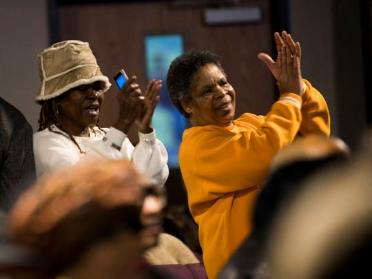 Attendees sing and clap along with the MLK Holiday Celebration Choir during the MLK Memorial Tribute Service held at Overcoming Believers Church in Knoxville, Tenn., on Monday, January 21, 2019.