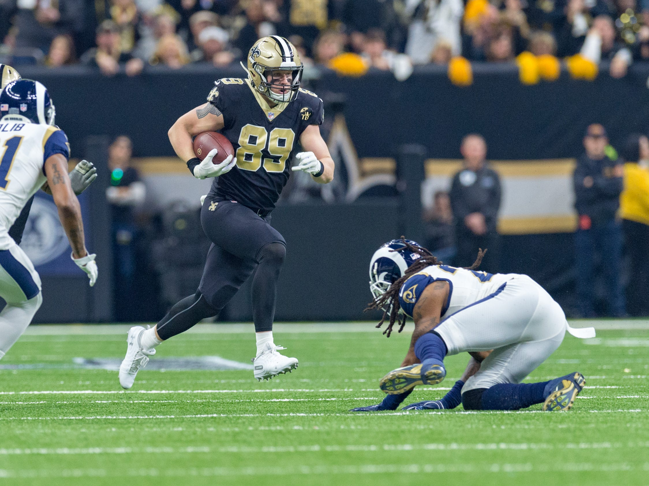 Saints tight end Josh Hill runs the ball during the NFC Championship playoff football game between the New Orleans Saints and the Los Angeles Rams at the Mercedes-Benz Superdome in New Orleans. Sunday, Jan. 20, 2019.